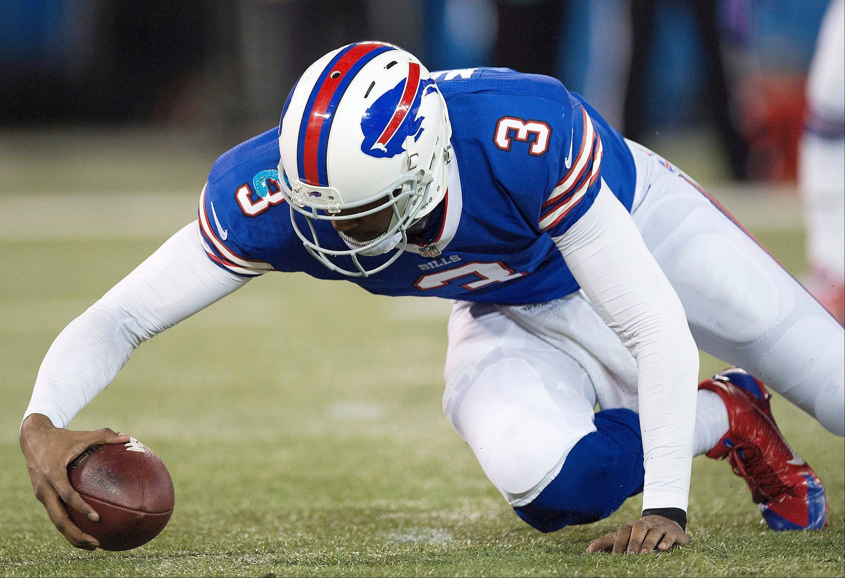 Buffalo Bills quarterback EJ Manuel recovers his own fumble against the Atlanta Falcons during first half NFL football action in Toronto on Sunday.