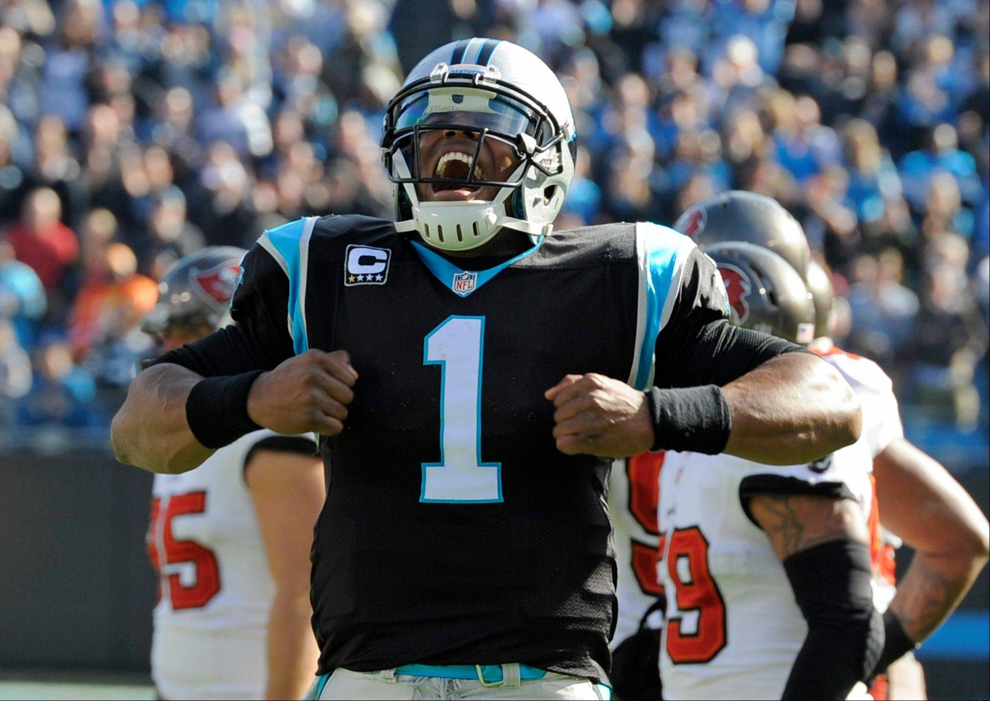 Carolina Panthers� Cam Newton (1) celebrates his touchdown pass against the Tampa Bay Buccaneers in the first half in Charlotte, N.C., Sunday.