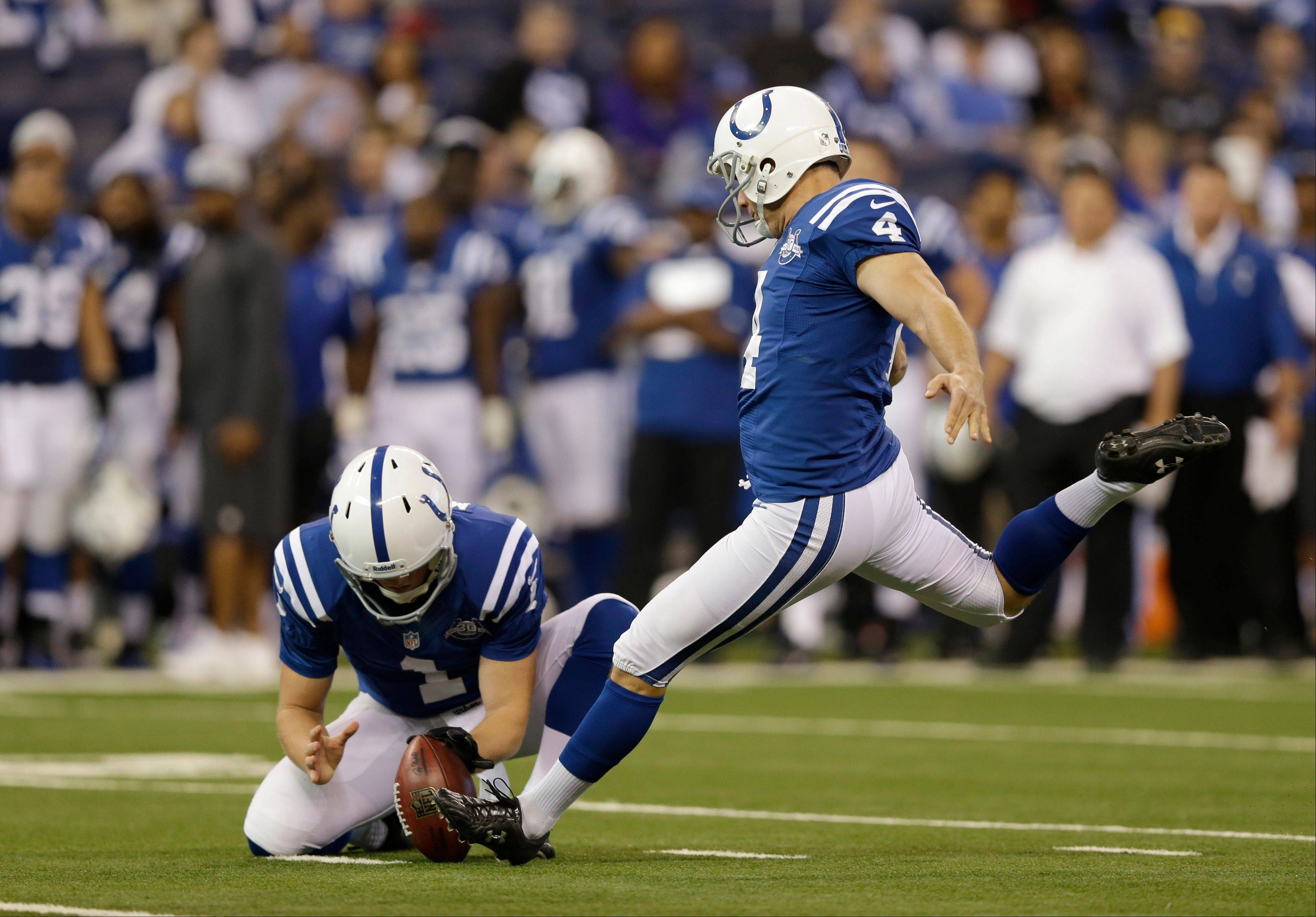 Indianapolis Colts� Adam Vinatieri (4) kicks a 37-yard field goal out of the hold of Pat McAfee during the first half against the Tennessee Titans Sunday, Dec. 1, 2013, in Indianapolis.