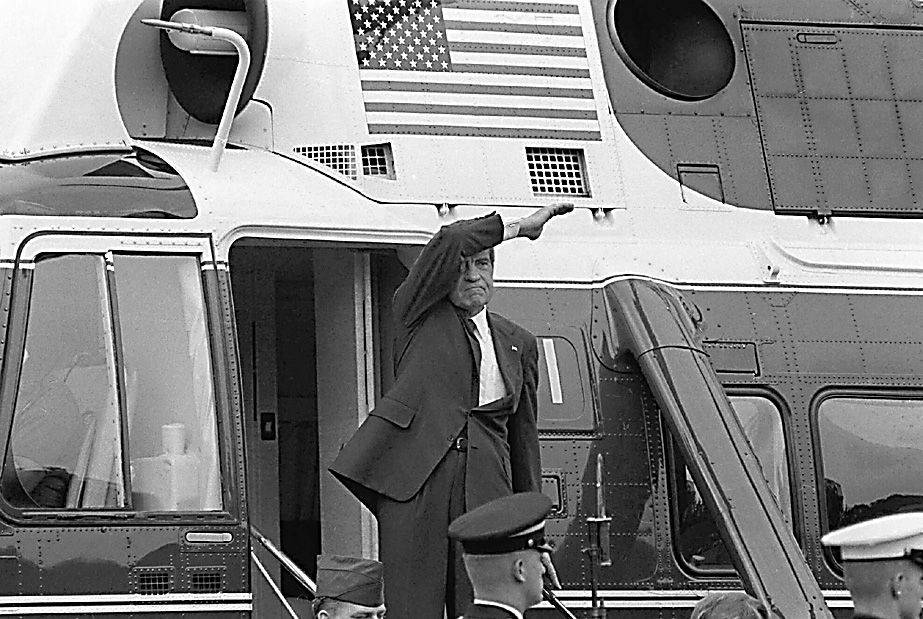 On the day of his resignation, Richard M. Nixon waves goodbye from the steps of his helicopter as he leaves the White House following a farewell address to his staff on Aug. 9, 1974.