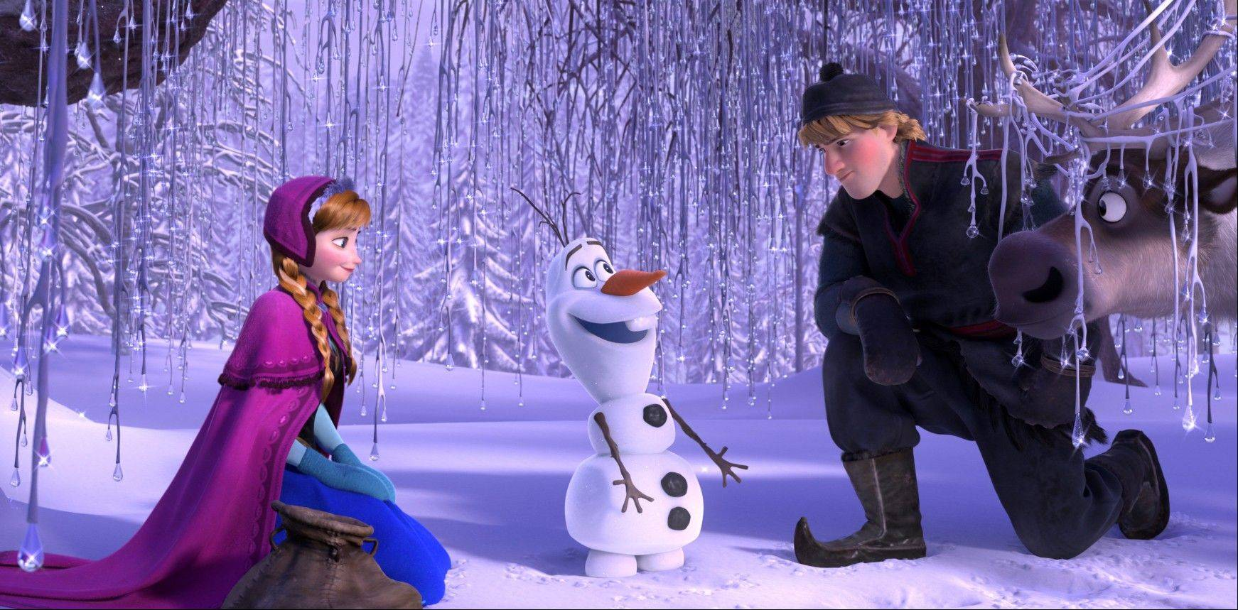 "This image released by Disney shows, from left, Anna, voiced by Kristen Bell, Olaf, voiced by Josh Gad, and Kristoff, voiced by Jonathan Groff in a scene from the animated feature ""Frozen."" The animated musical opened with $67 million over the Thanksgiving weekend making it the biggest opening on the holiday ever -- beating out ""Harry Potter and the Scorcer's Stone."""