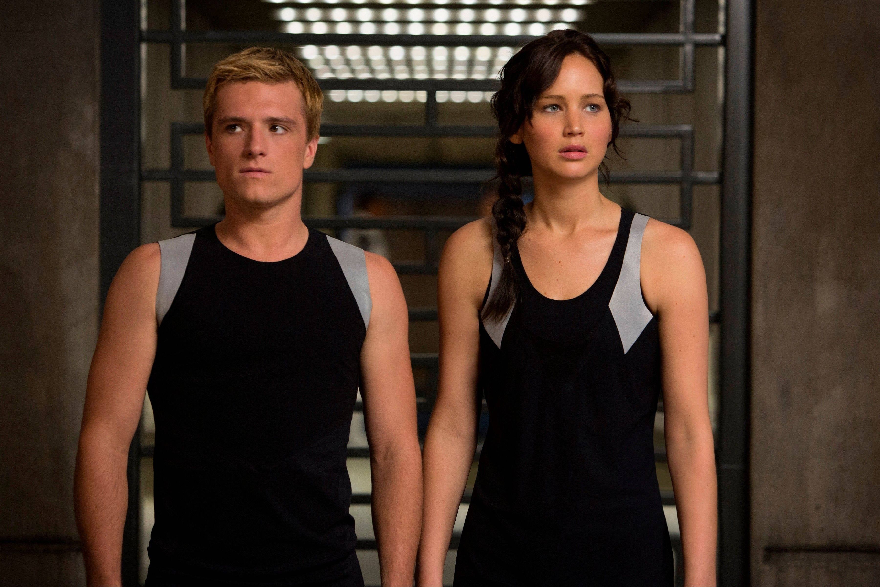 "This image released by Lionsgate shows Josh Hutcherson as Peeta Mellark, left, and Jennifer Lawrence as Katniss Everdeen in a scene from ""The Hunger Games: Catching Fire."" The movie hauled in $75 million in its second weekend of release."