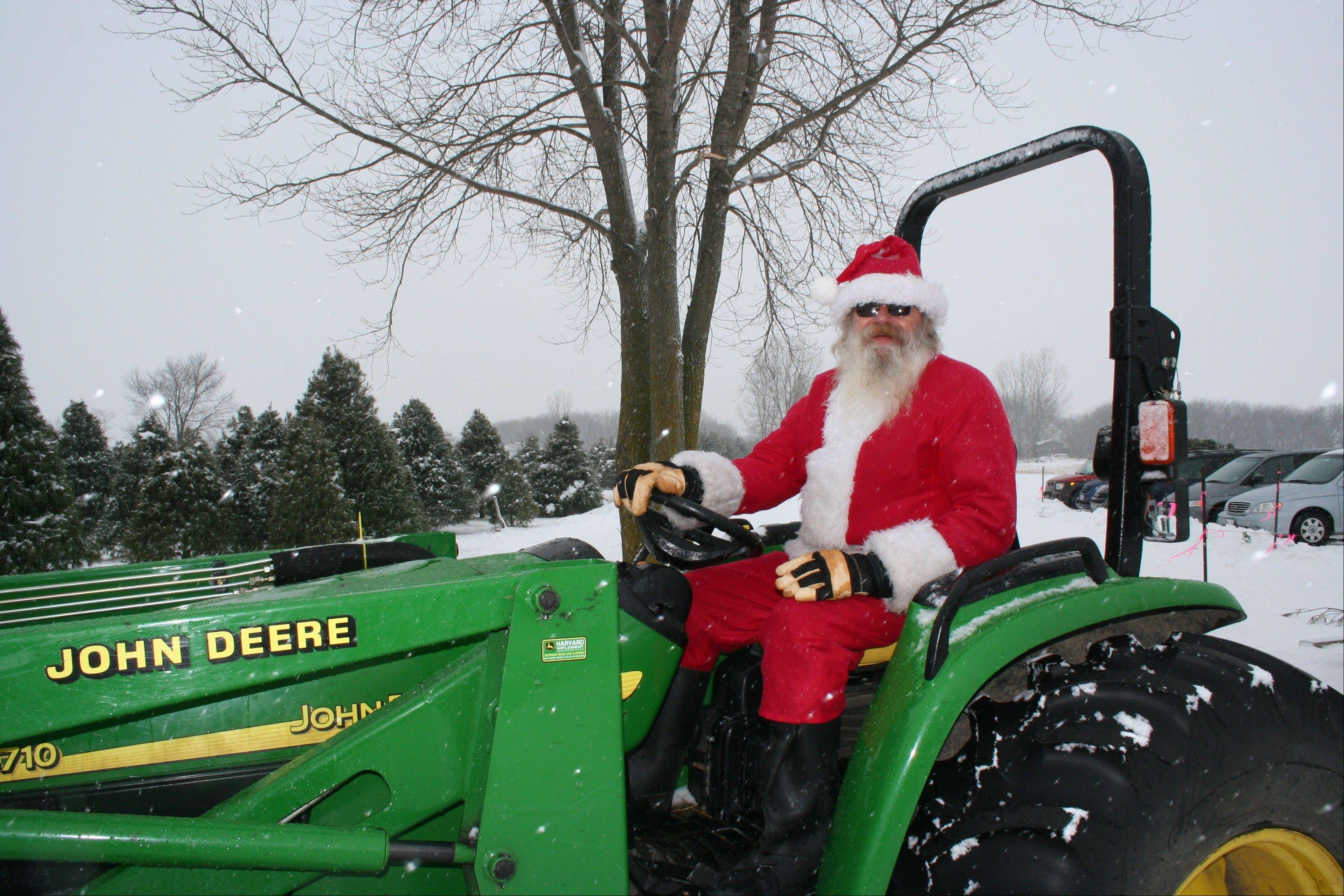 Santa trades his sleigh for a tractor at Ben's Christmas Tree Farm in Harvard.