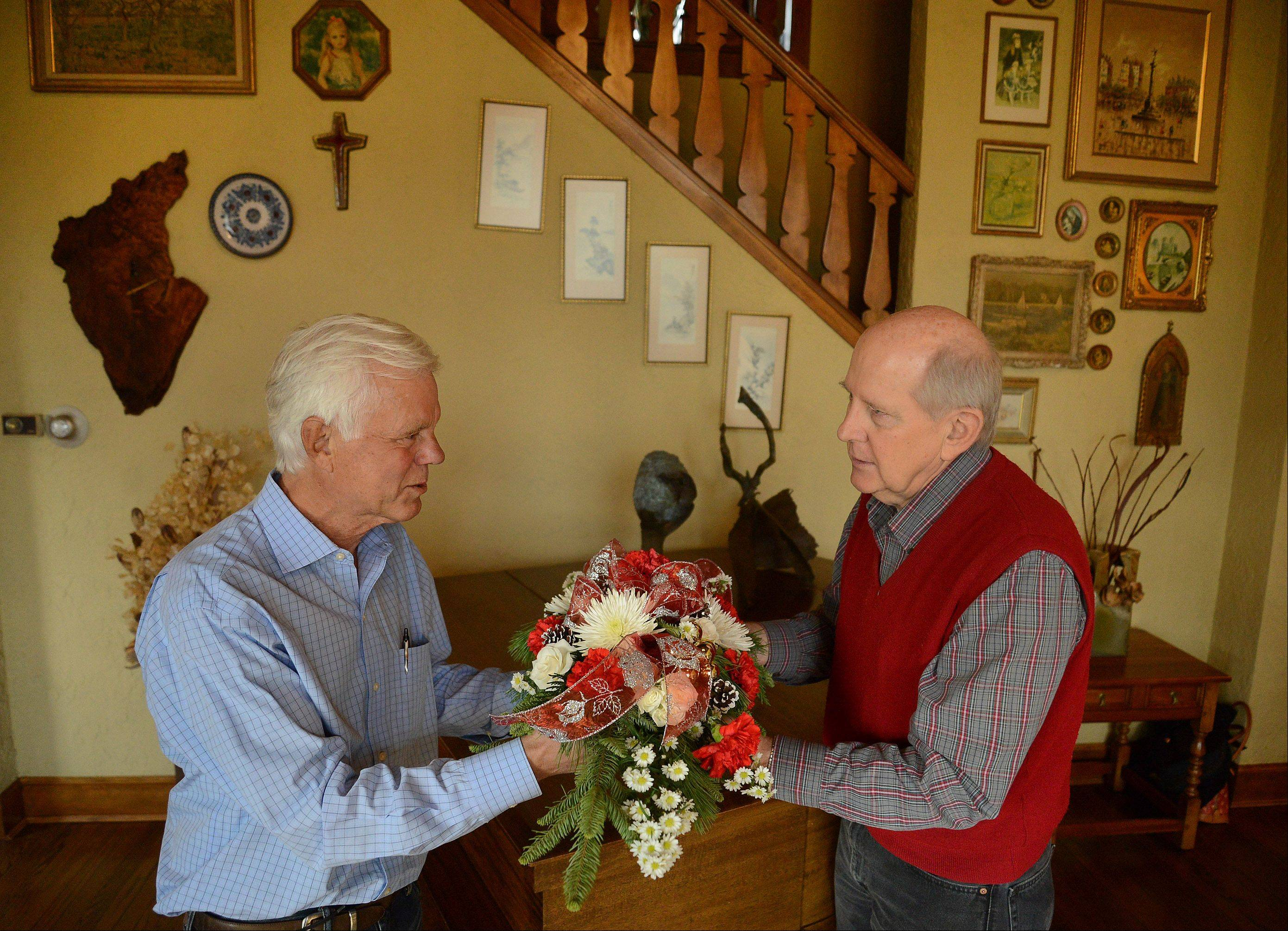 Larry Moats, left, consults with Paul Seils of Busse's Flowers, who will help decorate the Moats' family home for Mount Prospect's holiday housewalk.