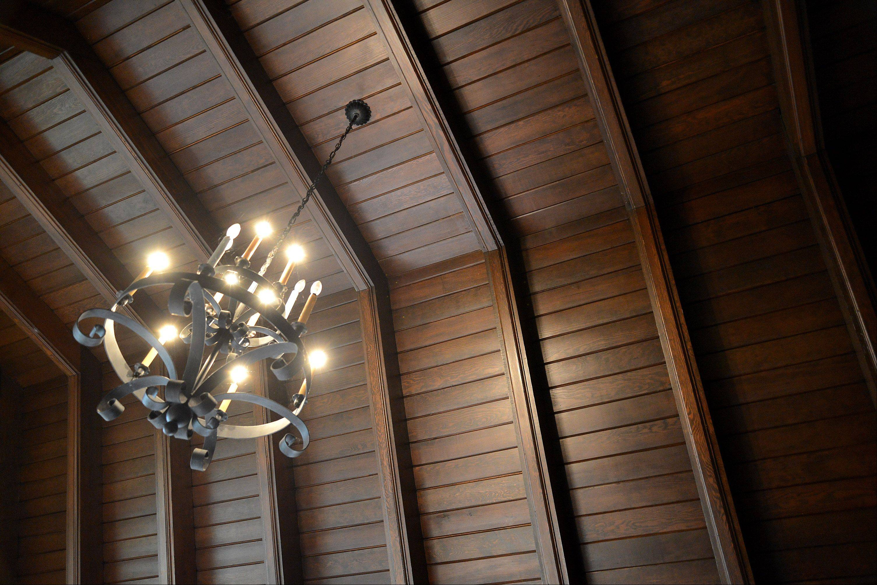 A wooden, vaulted ceiling soars over the living room of the Moats home.