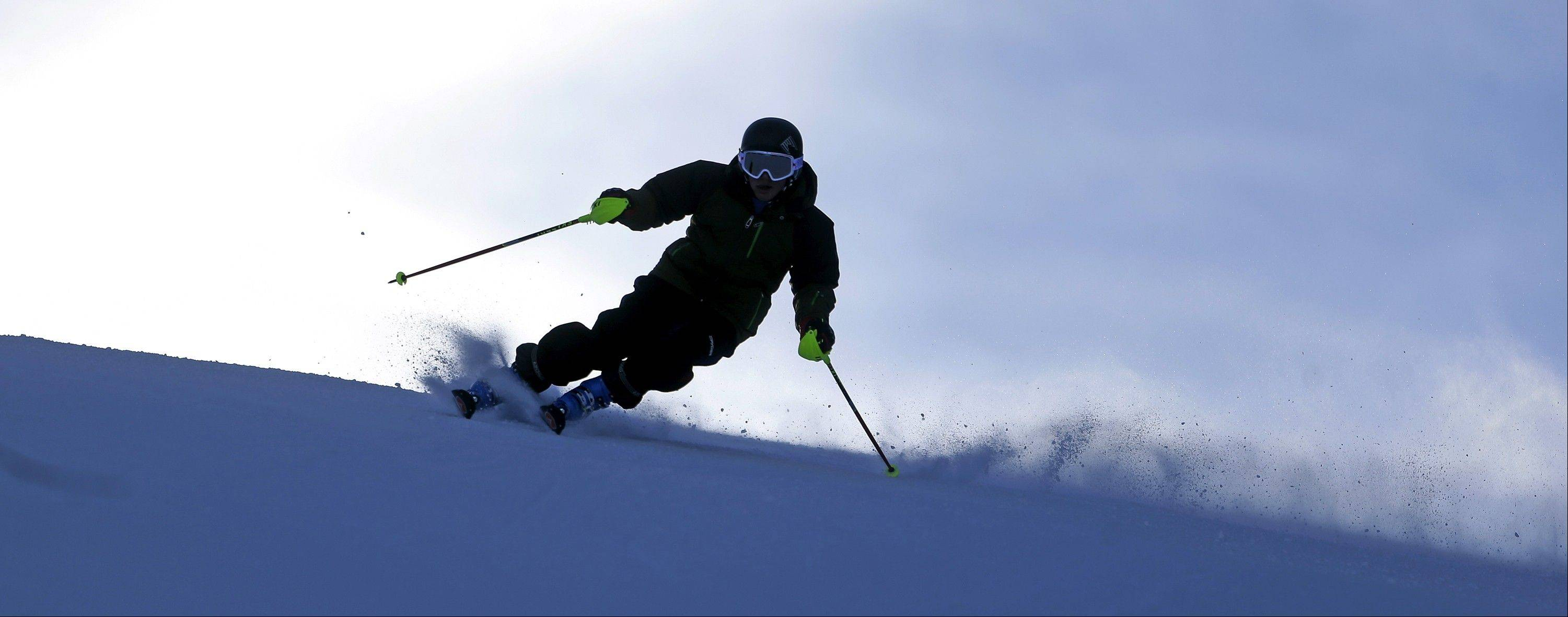 A skier takes to the slopes at Park City Mountain Resort in Park City, Utah. About half of Utah's 14 resorts are up and running on snow that piled up during November.
