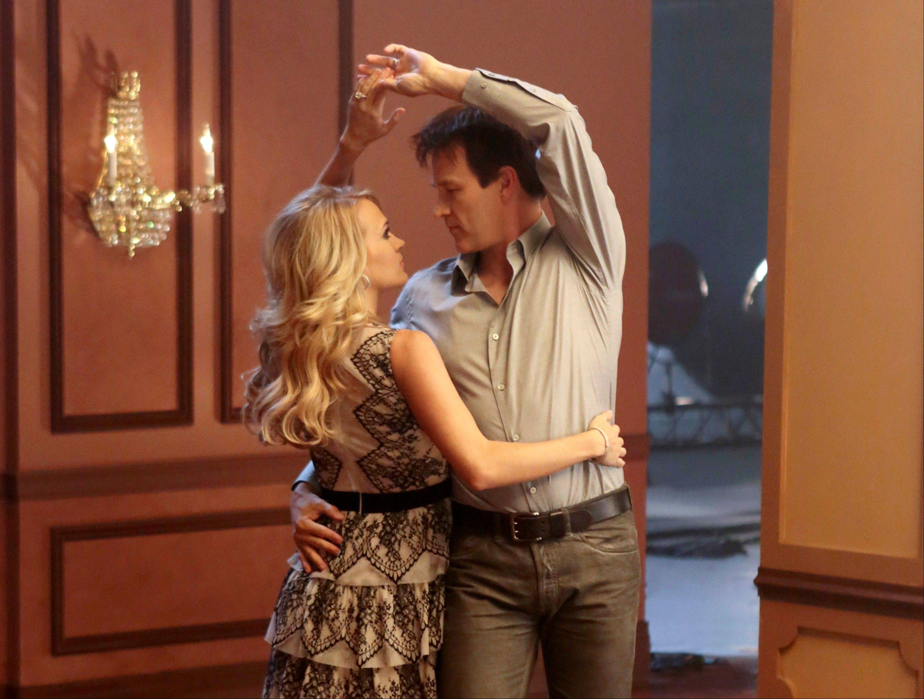 "Carrie Underwood, left, and Stephen Moyer rehearse a scene for ""The Sound of Music Live!,"" airing on NBC Thursday, Dec. 5."