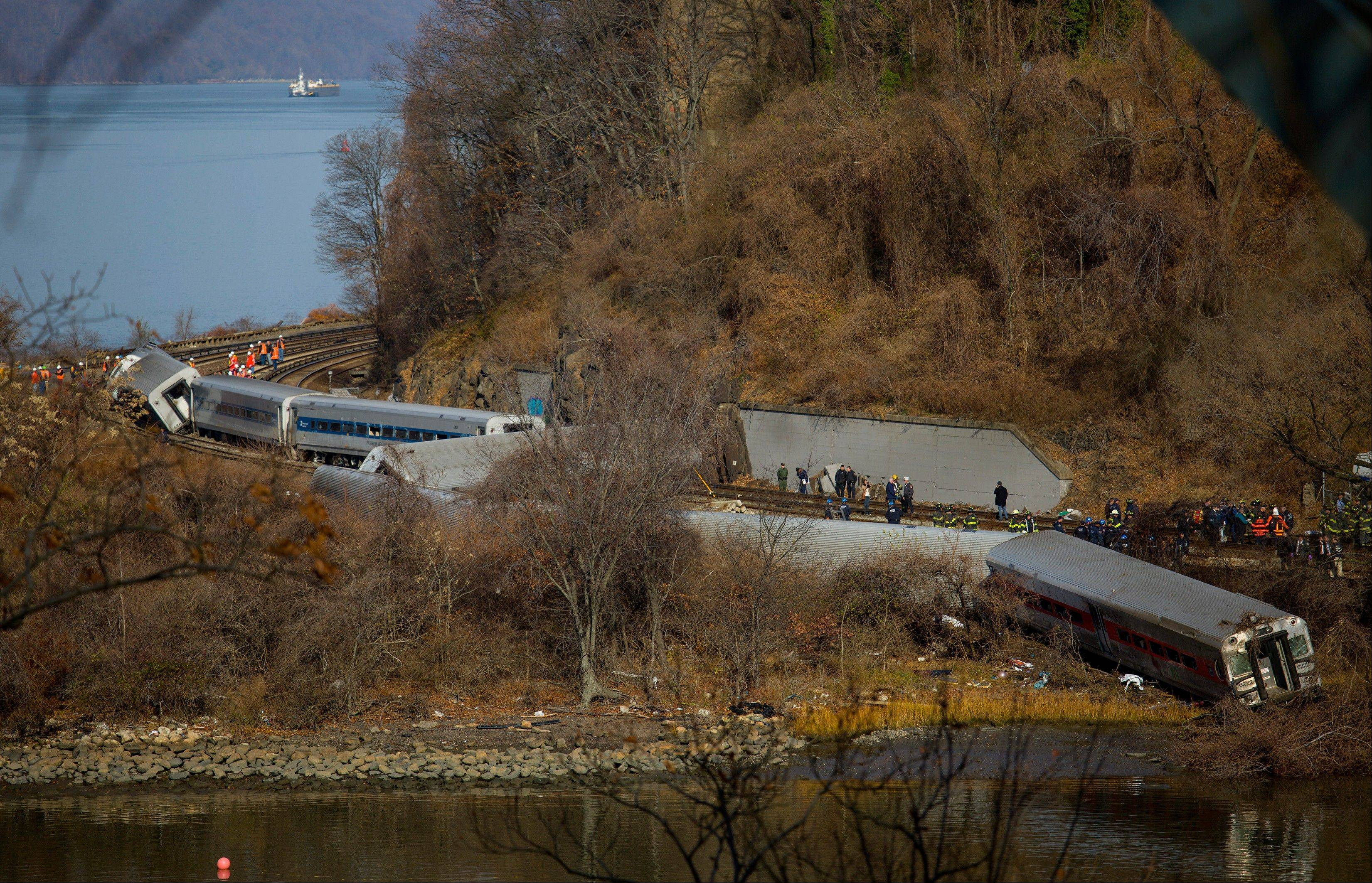 Emergency rescue personnel work the scene of a Metro-North passenger train derailment in the Bronx borough of New York.