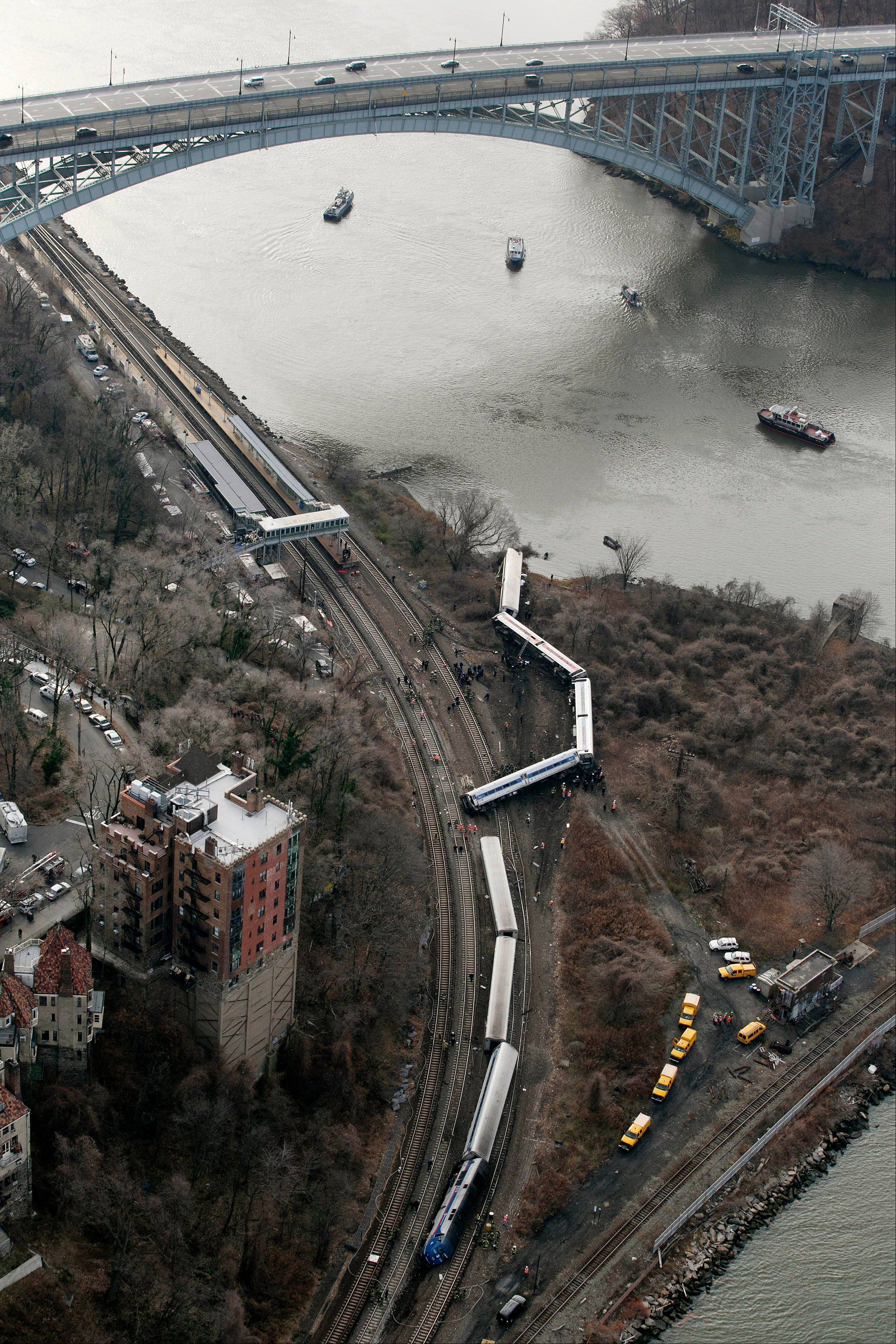 A Metro-North passenger train lays on its side after derailing in the Bronx borough of New York.