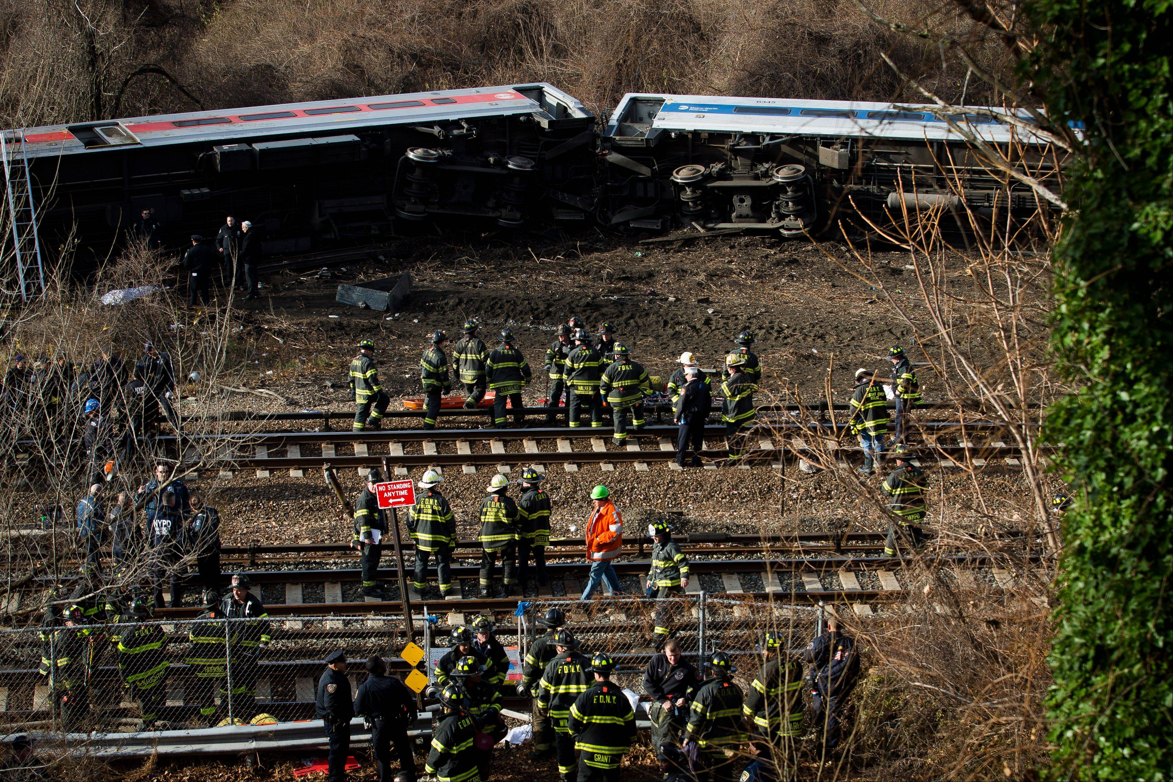 Emergency personnel respond to the scene of a Metro-North passenger train derailment in the Bronx borough of New York, Sunday.