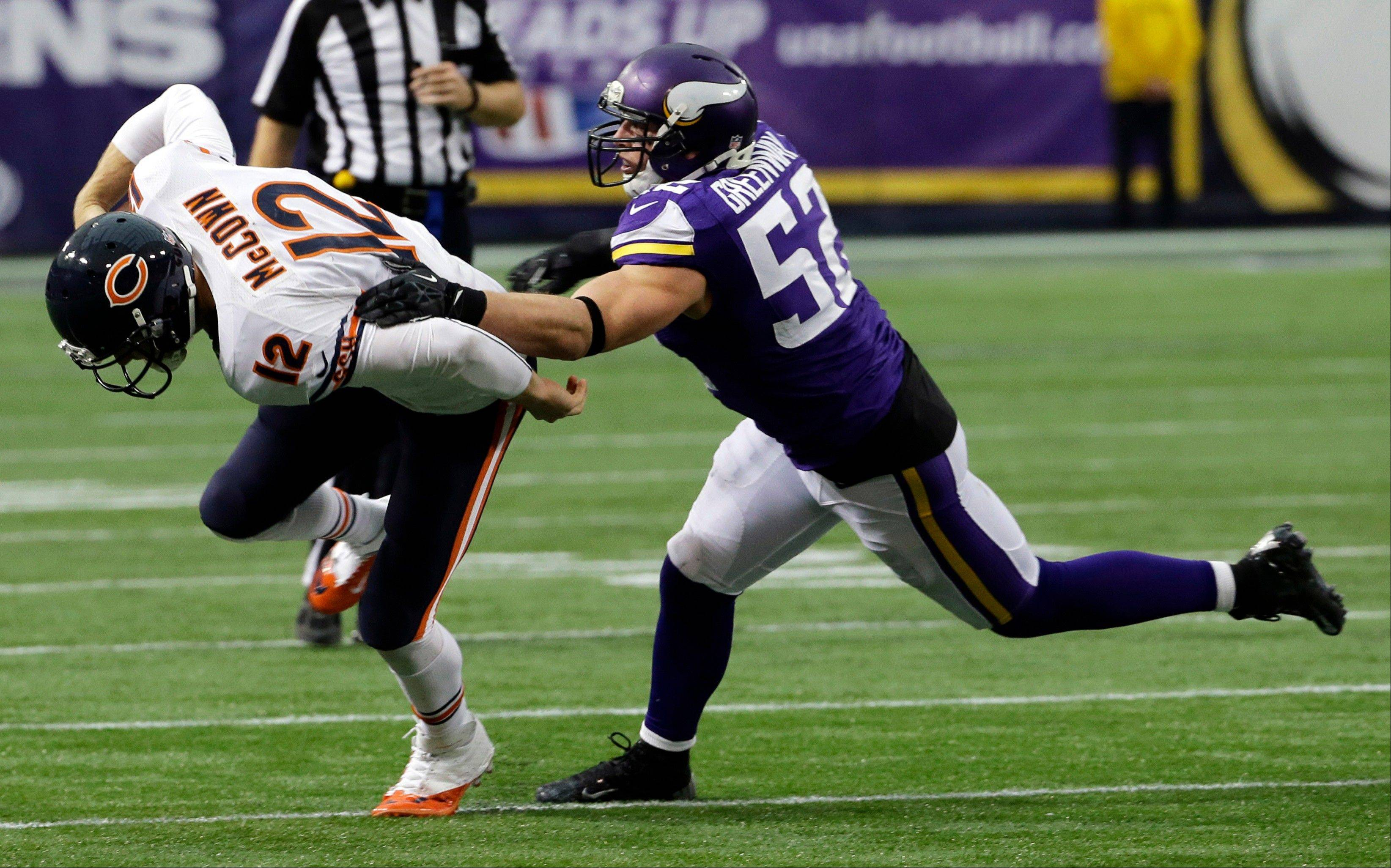 Chicago Bears quarterback Josh McCown, left, runs from Minnesota Vikings outside linebacker Chad Greenway during the first half of an NFL football game on Sunday, Dec. 1, 2013, in Minneapolis.