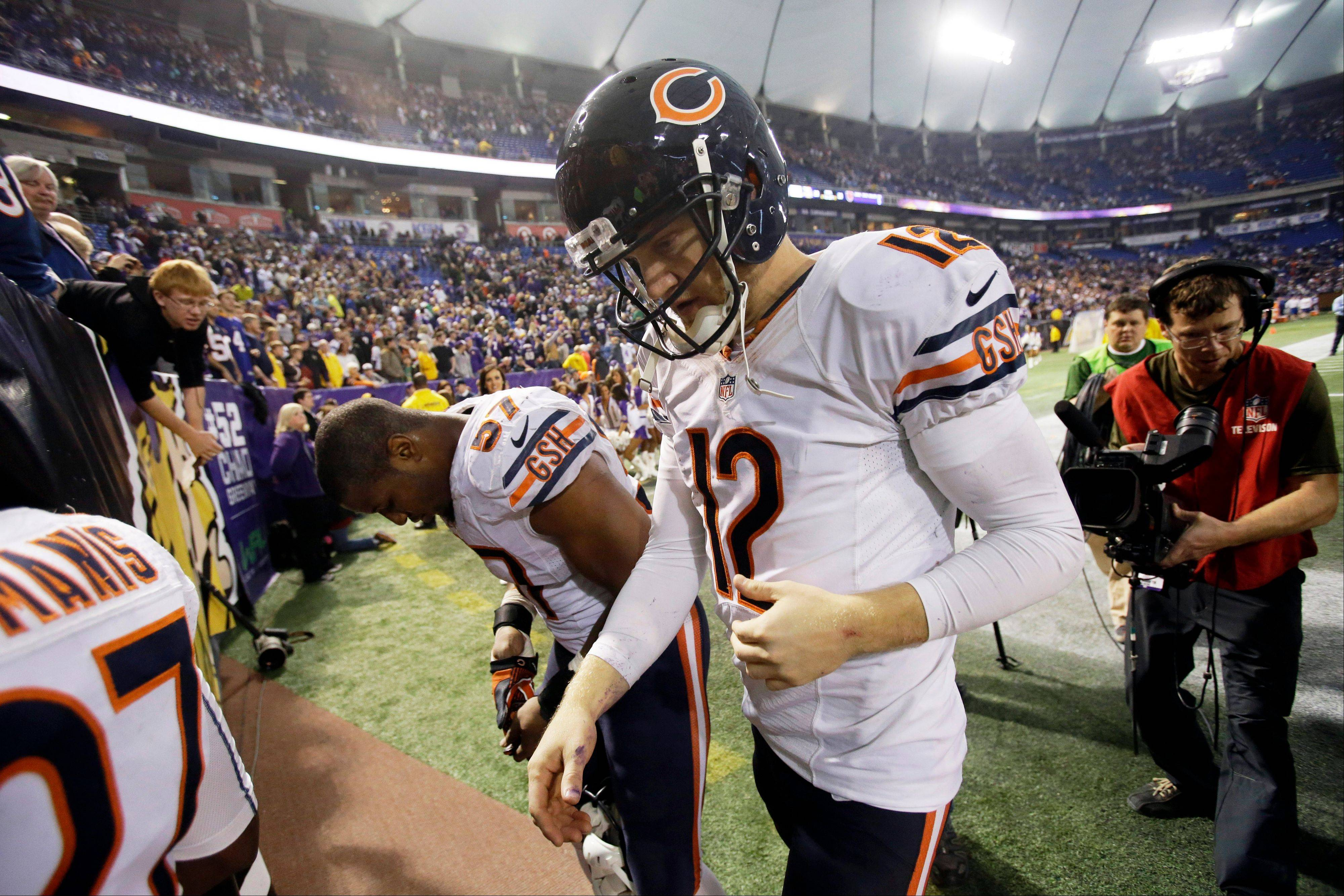 Chicago Bears quarterback Josh McCown (12) walks off the field after an NFL football game against the Minnesota Vikings. The Vikings won 23-20 in overtime.