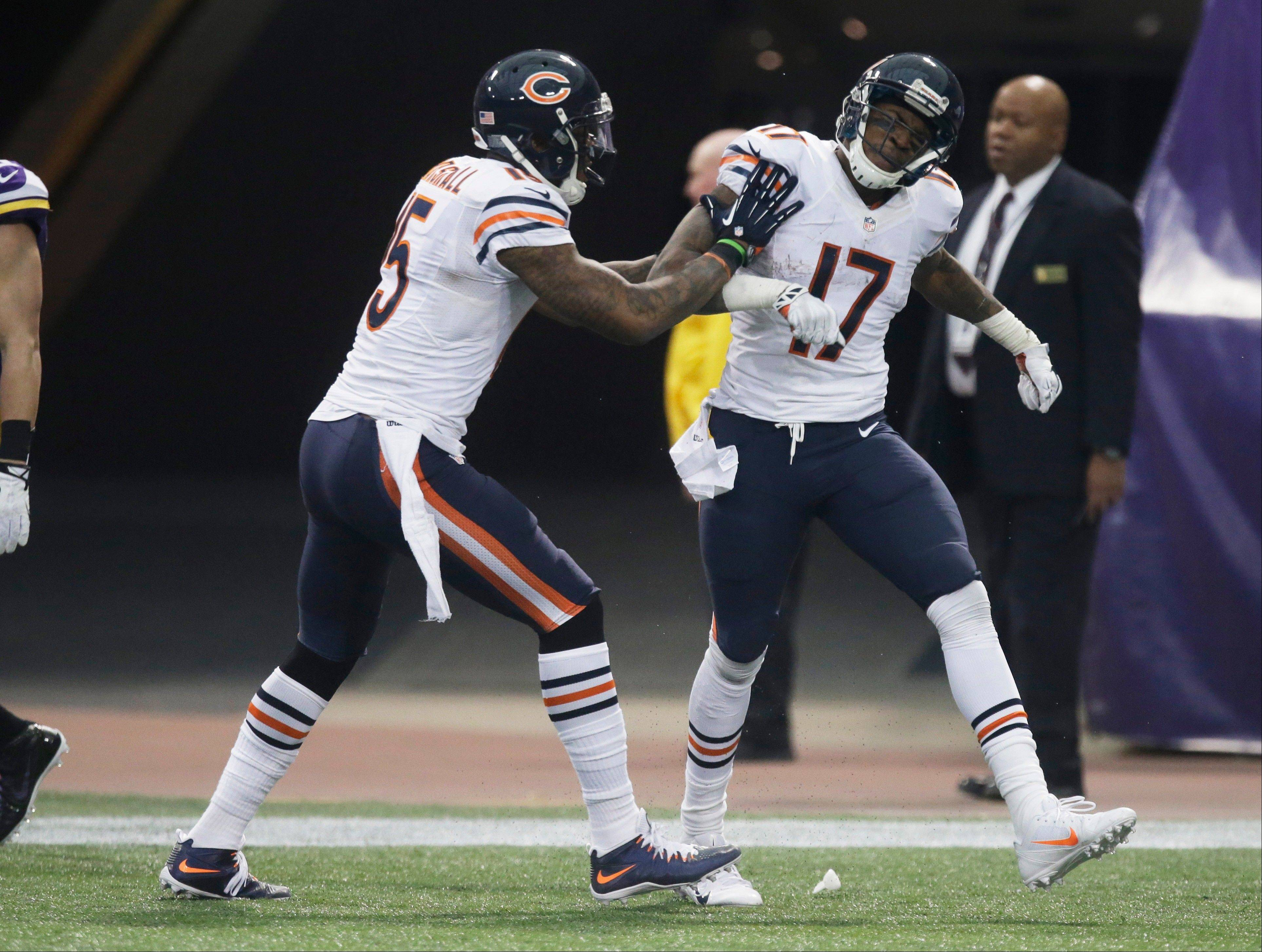 Chicago Bears wide receiver Alshon Jeffery (17) celebrates with teammate Brandon Marshall after catching a 46-yard touchdown pass during the second half.
