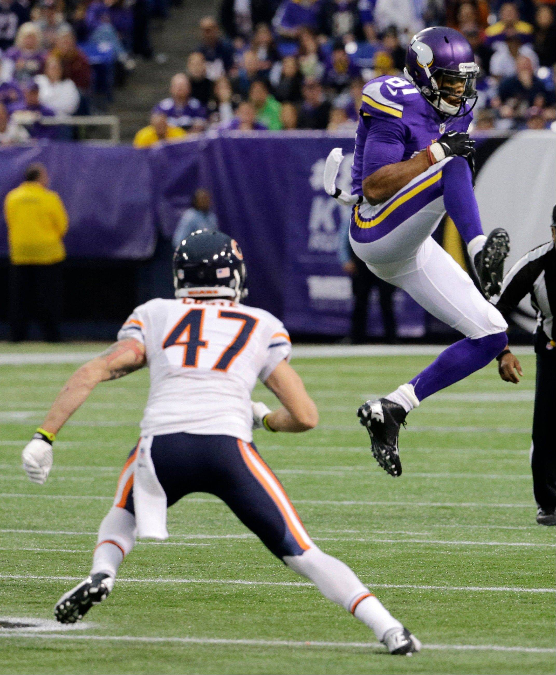 Minnesota Vikings wide receiver Jerome Simpson, right, catches a pass over Chicago Bears free safety Chris Conte during the second half.