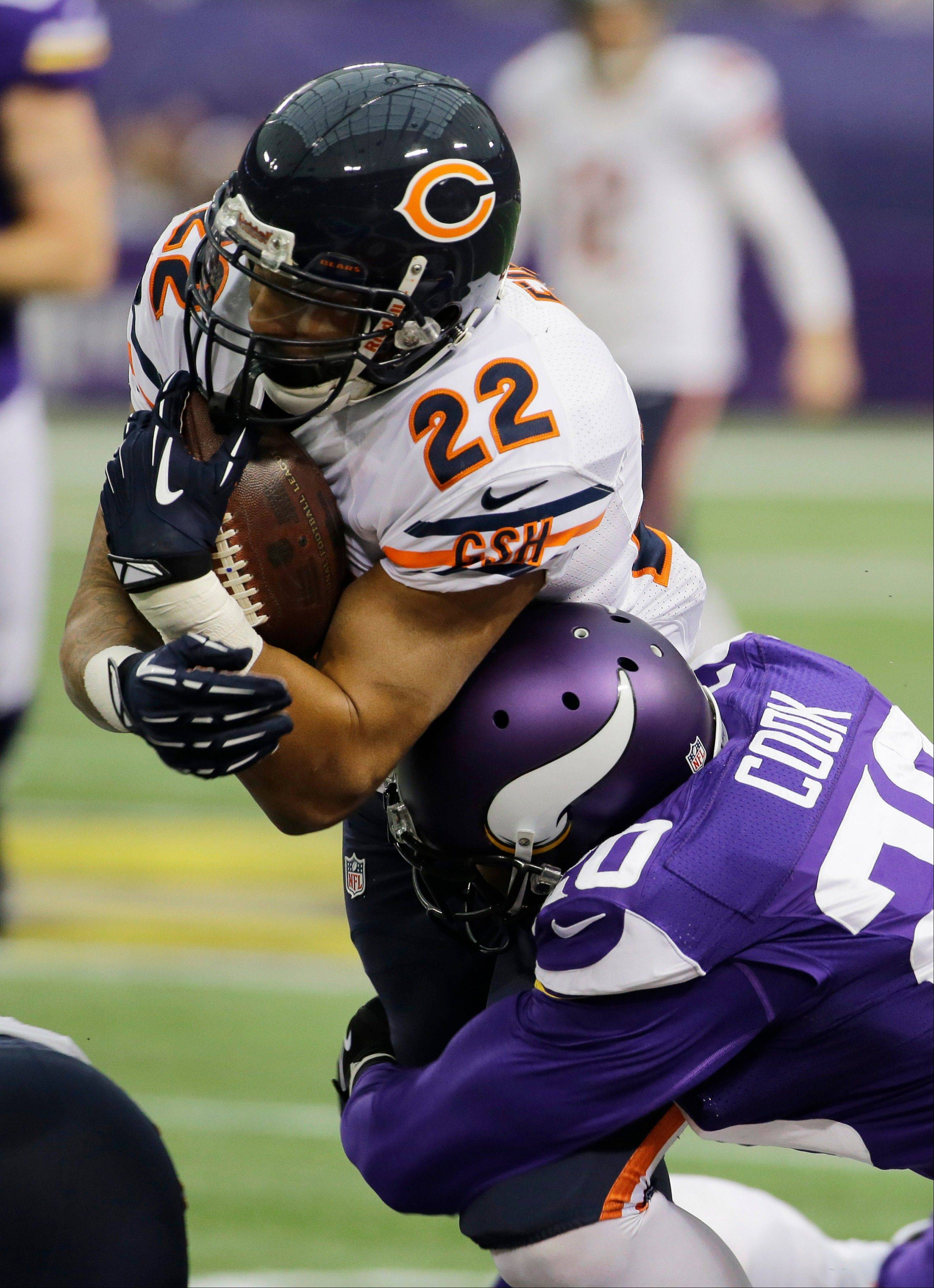 Chicago Bears running back Matt Forte (22) is tackled by Minnesota Vikings cornerback Chris Cook during the first half.