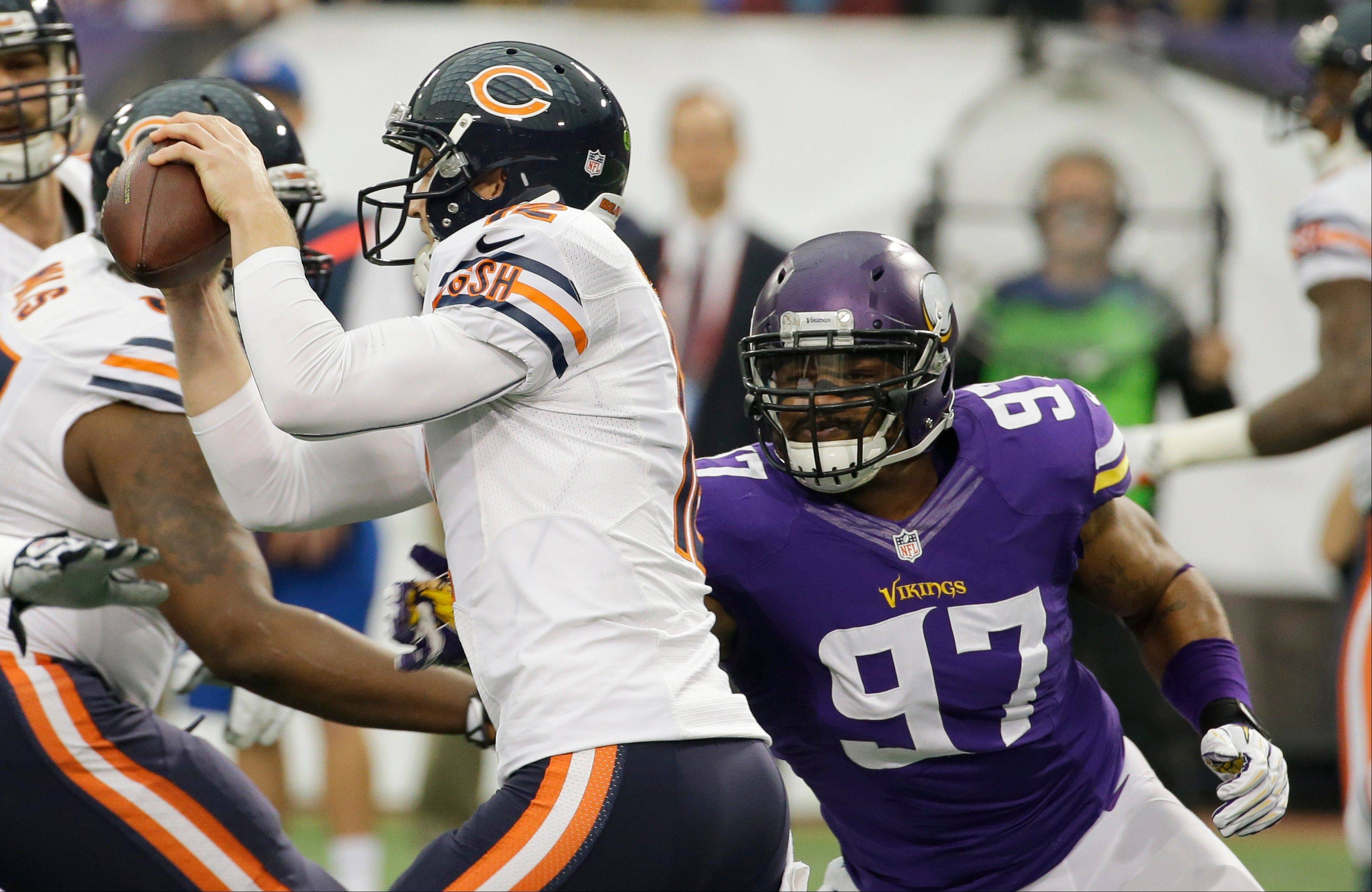 Chicago Bears quarterback Josh McCown, left, runs from Minnesota Vikings defensive end Everson Griffen during the first half.