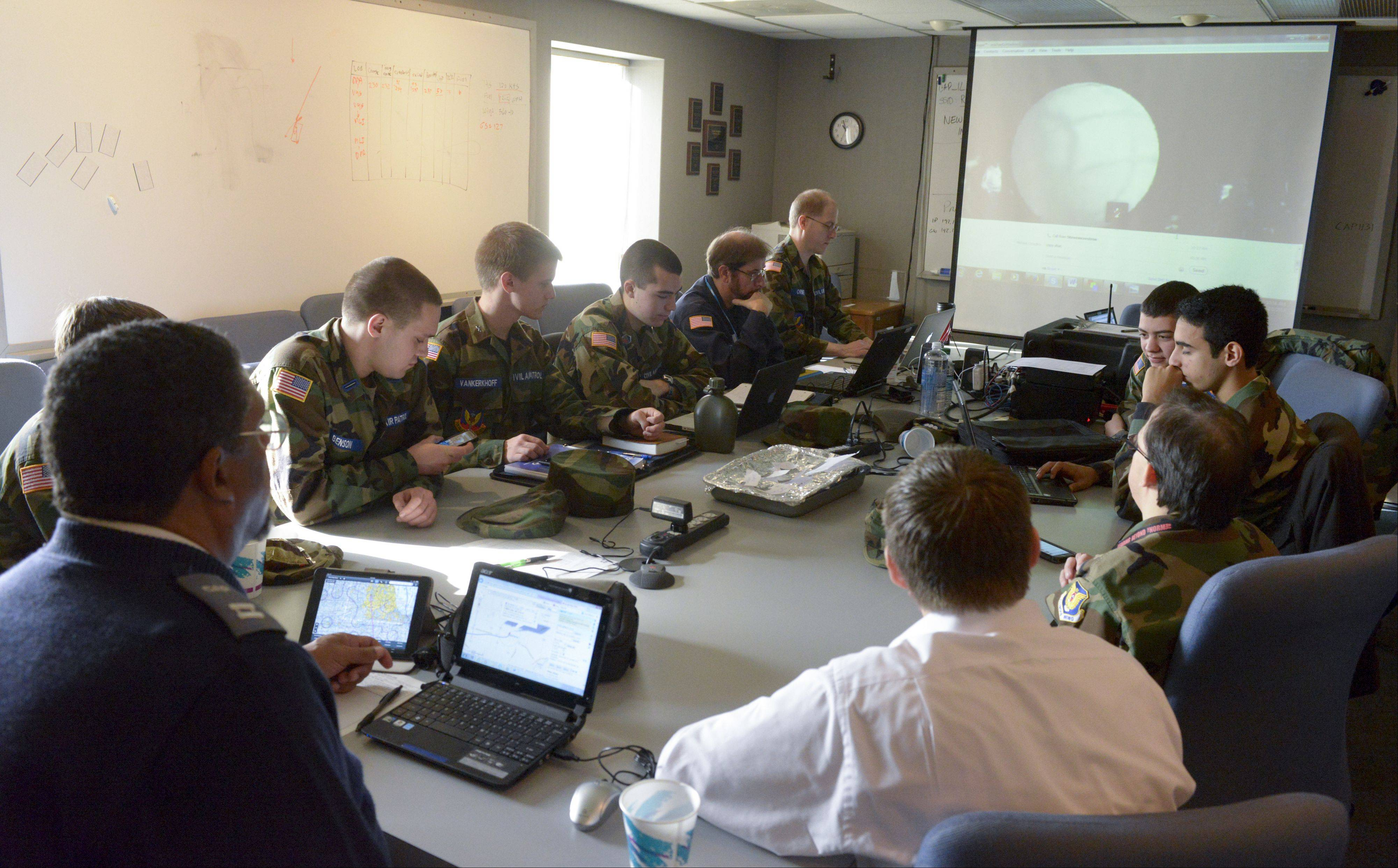 Members of the Fox Valley Composite Squadron of the Civil Air Patrol prepare for an attempt at the world record for highest paper airplane flight at the DuPage Airport, which served as mission control.