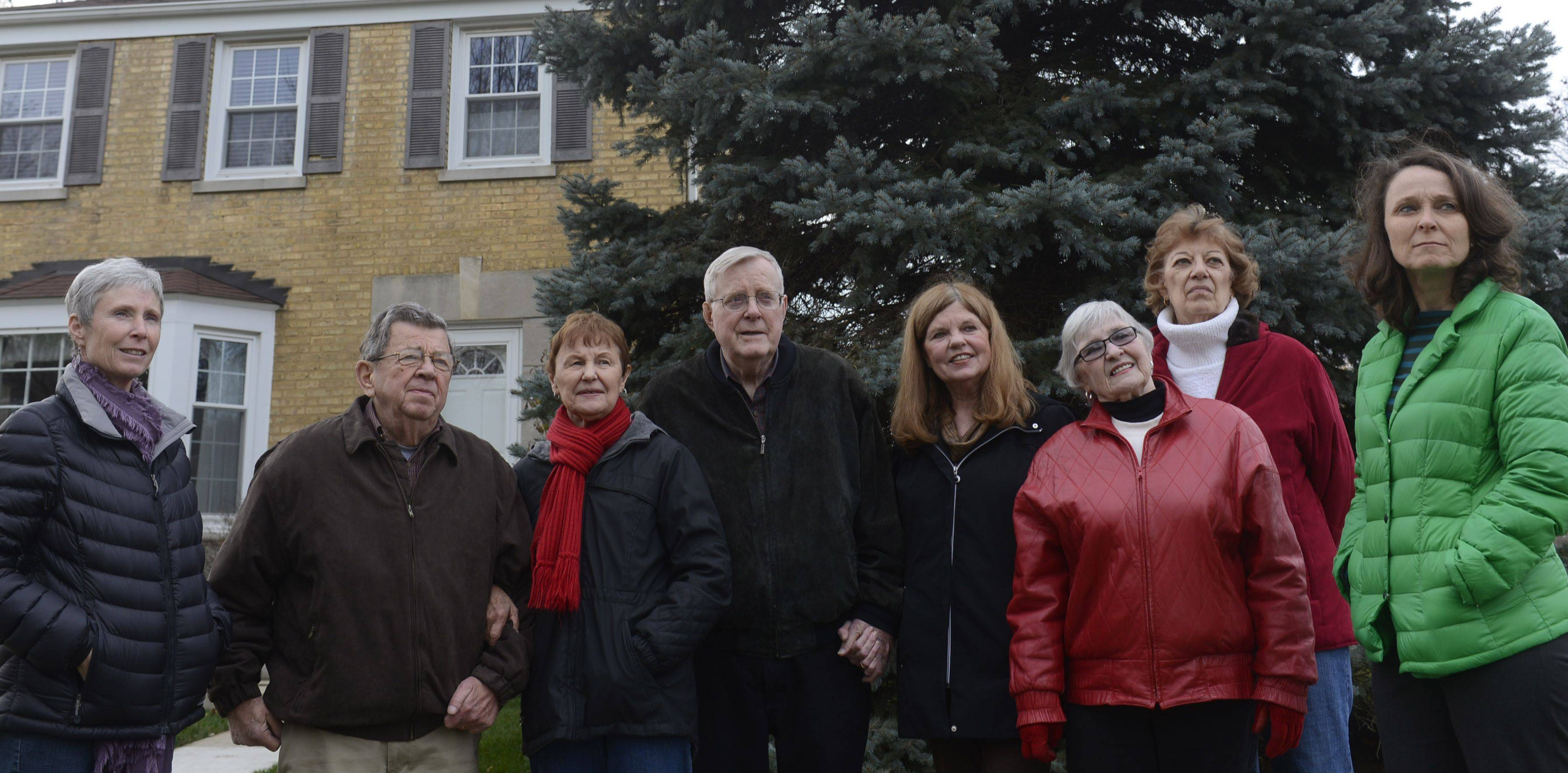 Neighbors, left to right, Sue Lello, Larry and Rosemary Hinkemeyer, Tom and Renae McGovern, Carol Tortorello, Roberta Edmonson and Lorelei McDermott stand in front of a tree planted in memory of Tommy McGovern.