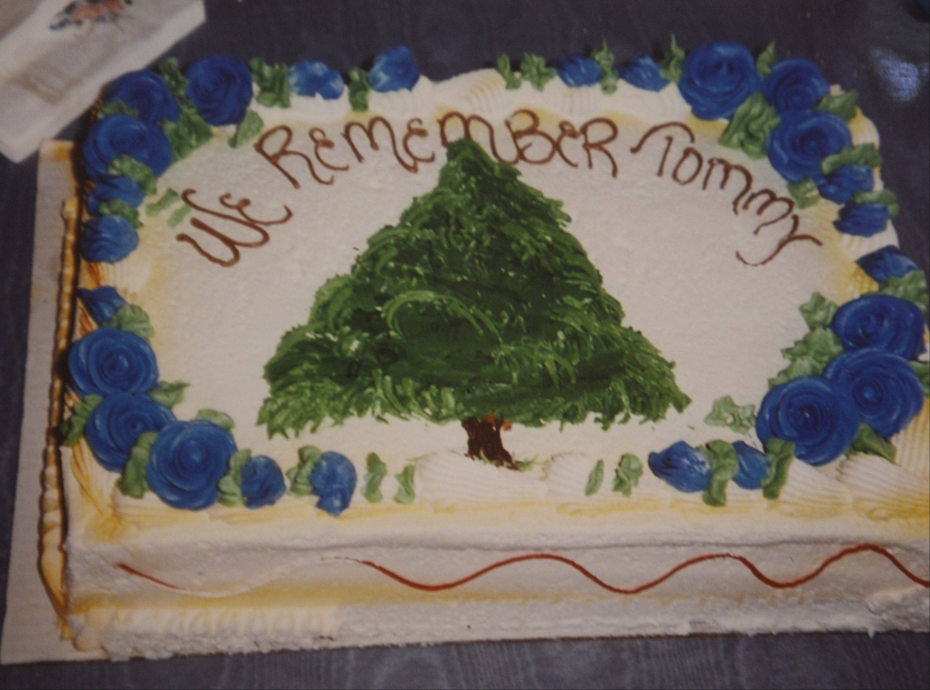 With the help of their friends and neighbors, the McGovern family planted an evergreen tree in memory of Tommy McGovern in front of their home on Pine Street in Mount Prospect on May 7, 1992. This cake was part of the celebration.