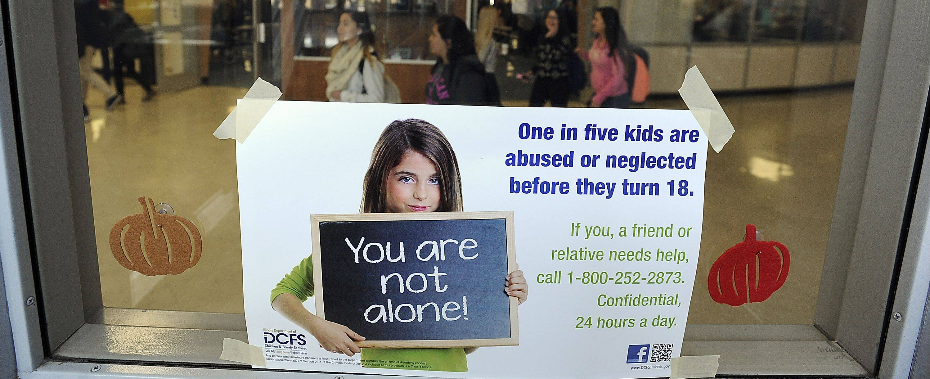 "The Illinois Department of Children and Family Services has launched a new statewide ""You are not alone"" campaign to stop child abuse and neglect. This poster is being displayed in the hallways of Maine West High School in Des Plaines."