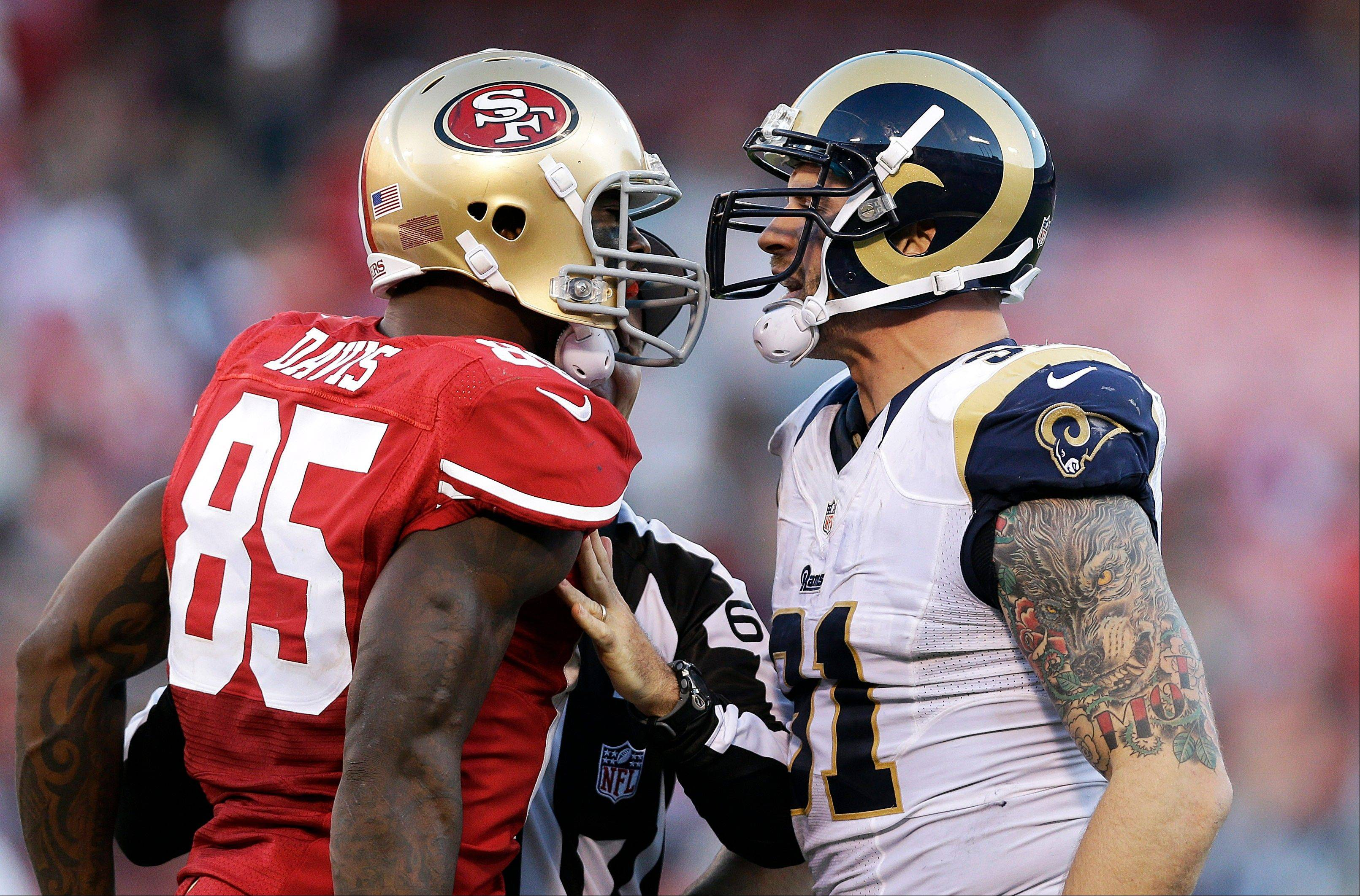 San Francisco 49ers tight end Vernon Davis (85) faces off with St. Louis Rams defensive end Chris Long during the fourth quarter in San Francisco.