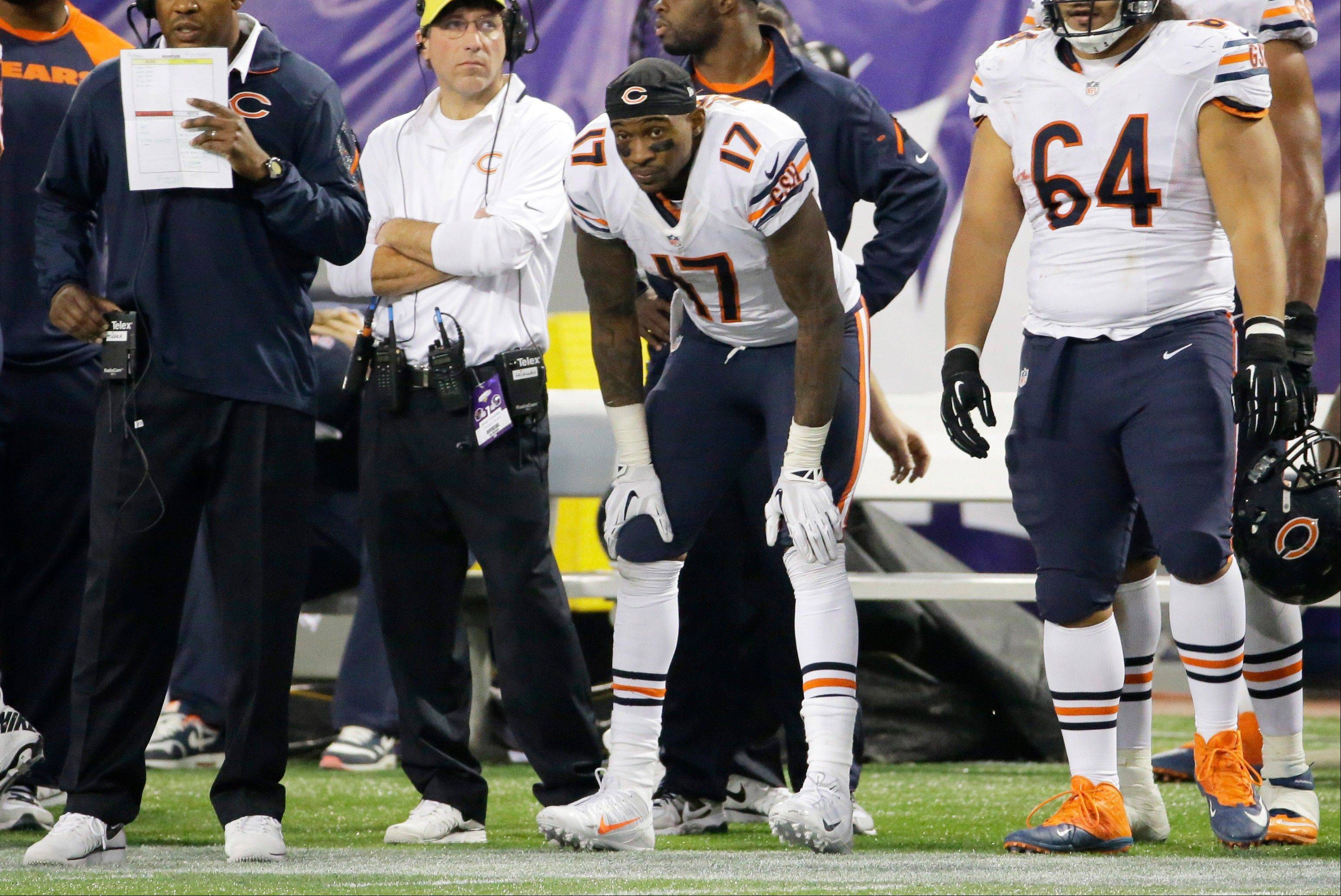 Wide receiver Alshon Jeffery, after almost single-handedly lifting the Bears to victory with a pair of highlight-reel touchdown catches, can do little but look on from the sideline during Sunday's overtime.