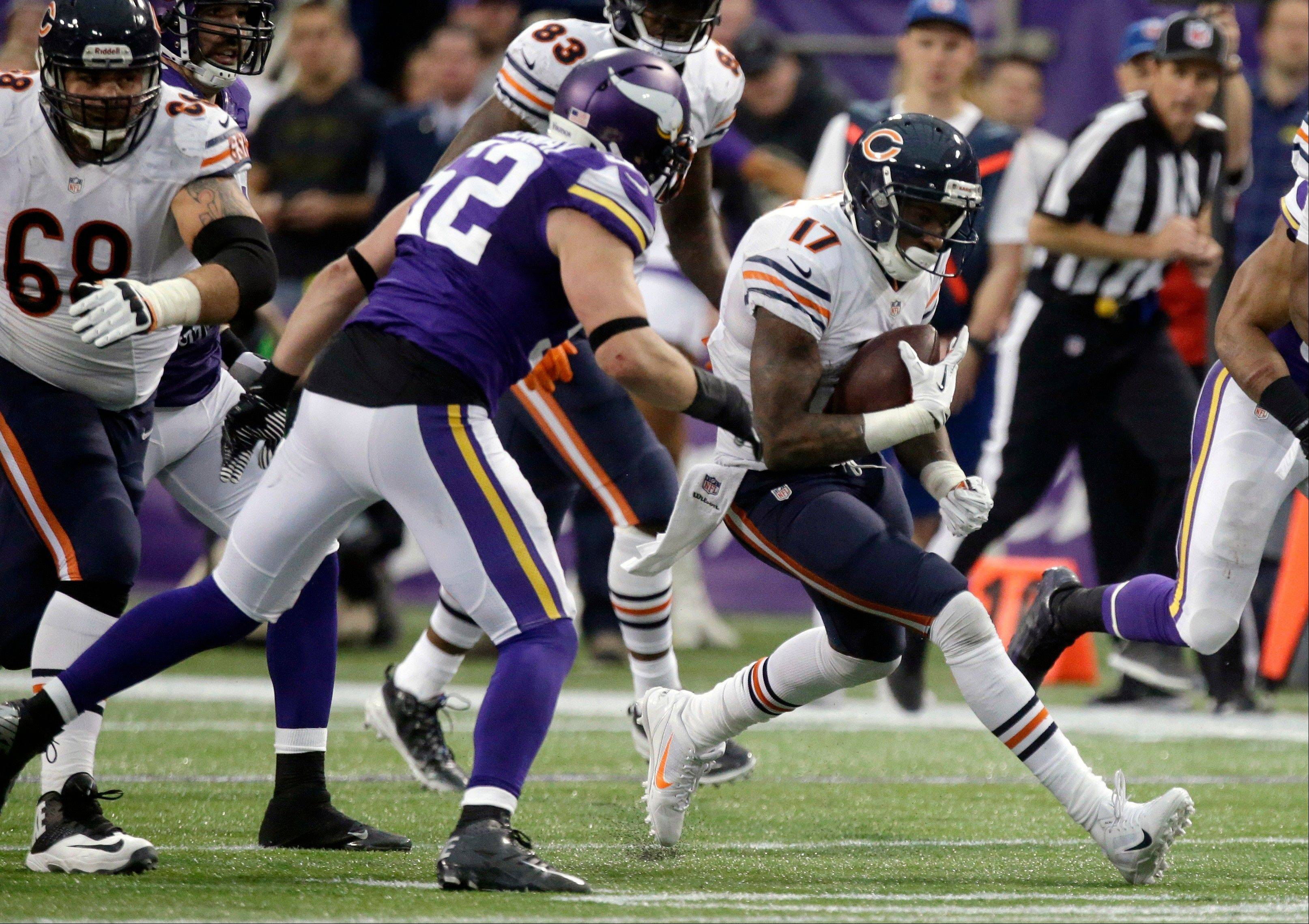 Chicago Bears wide receiver Alshon Jeffery (17) runs from Minnesota Vikings outside linebacker Chad Greenway, left, after making a reception during the second half.