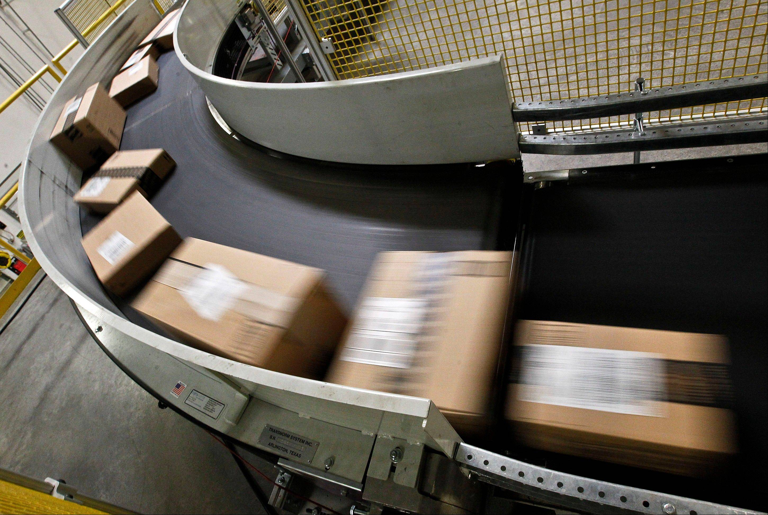 Packages are ready to ship move along a conveyor belt at the Amazon.com 1.2 million square foot fulfillment center, in Phoenix. Millions of shoppers are expected to click on items on Monday, Dec. 2, 2013, as retailers rev up deals to grab online holiday shopping dollars on the first working day after the busy holiday weekend.