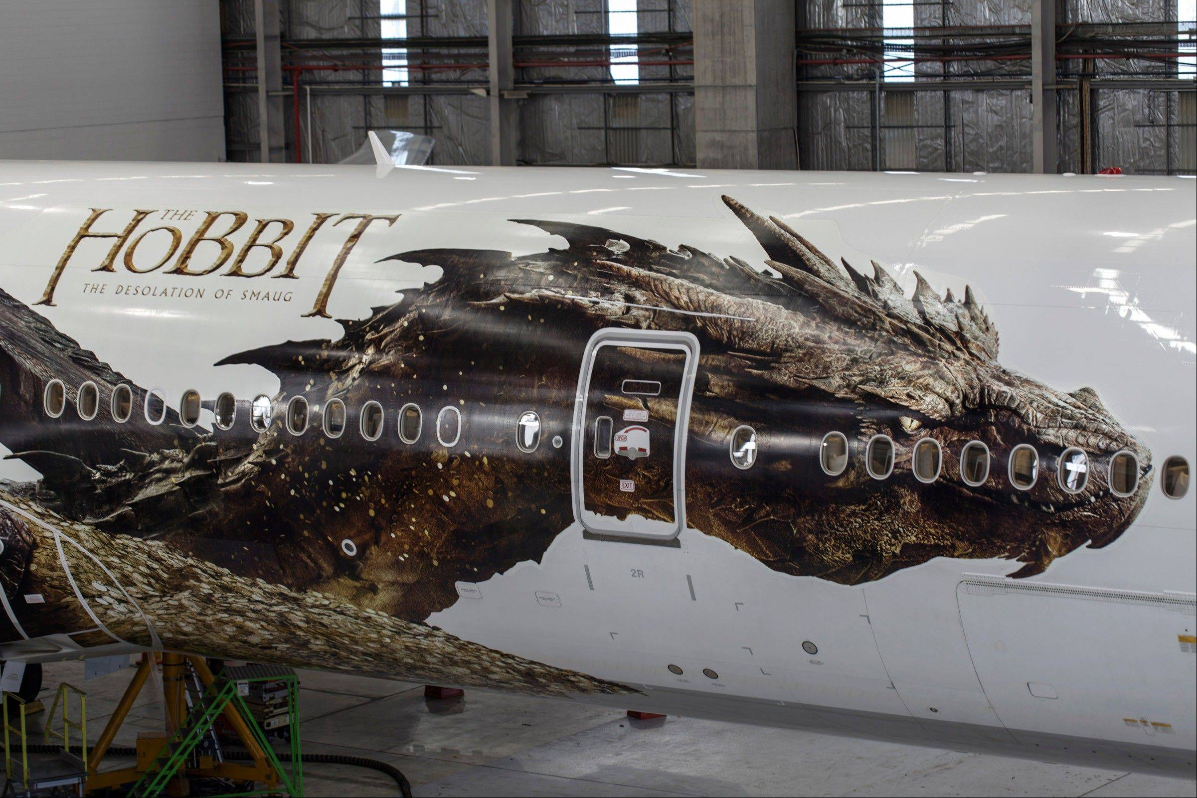 "The dragon Smaug from Peter Jackson's Hobbit trilogy is debuting on the side of an Air New Zealand plane in Auckland, New Zealand. The image was unveiled to celebrate the premiere of ""The Hobbit: The Desolation of Smaug,"" which screens Monday in Los Angeles."