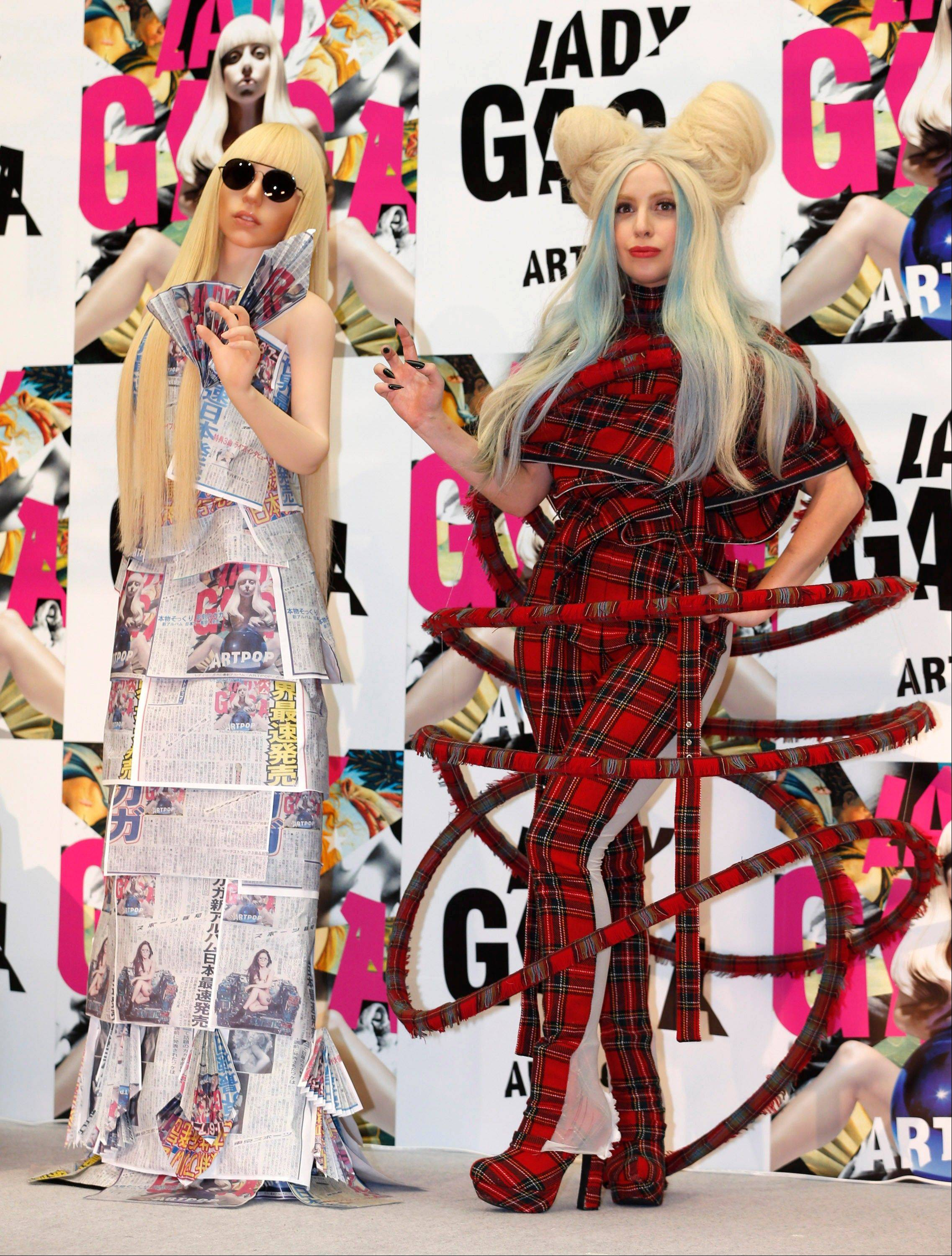 "Lady Gaga poses with her life-size doll during a news conference to promote her album ""ARTPOP"" in Tokyo Sunday."
