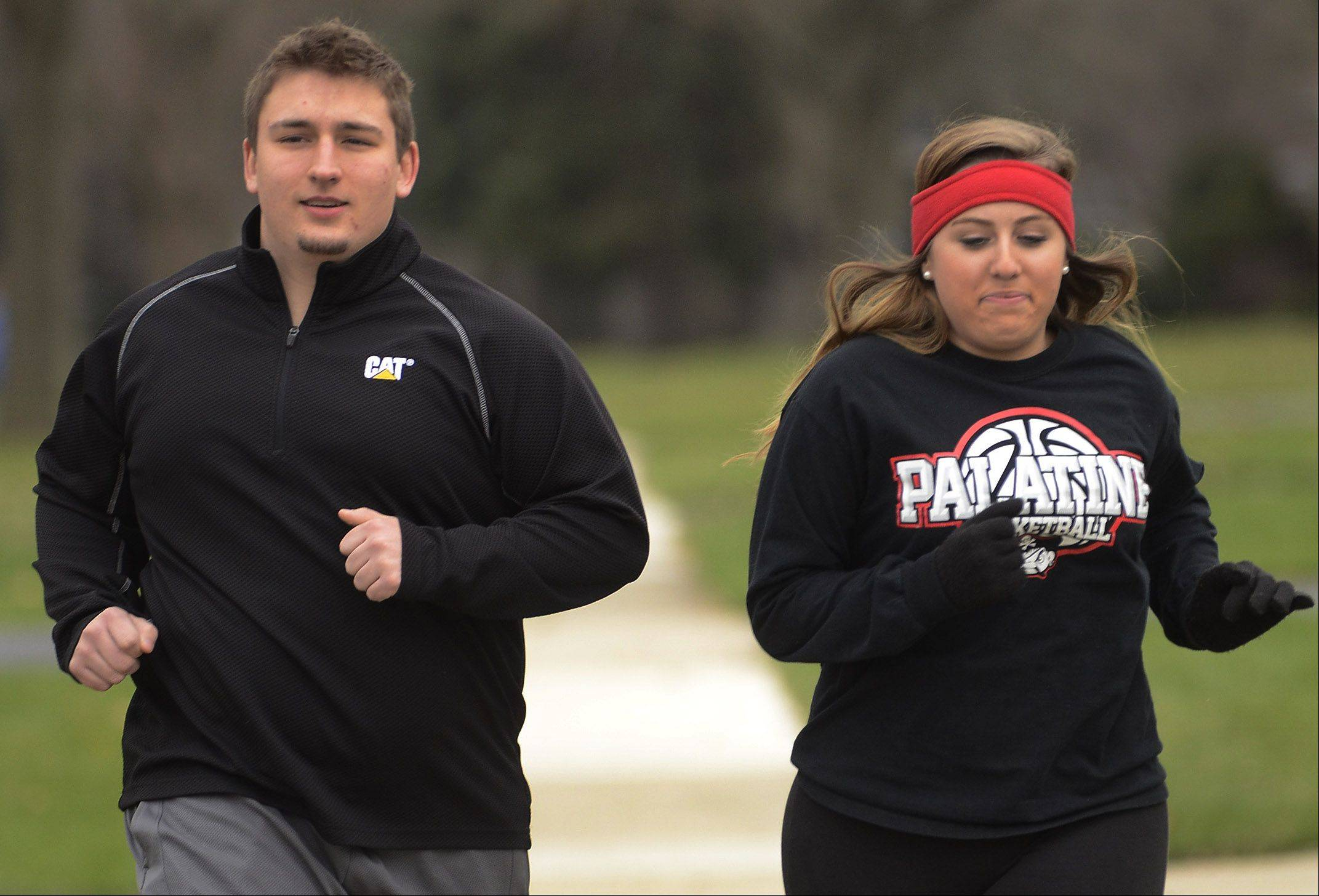 2013 Fittest Loser contestant Joe Gundling and his girlfriend Jen run to keep in shape.