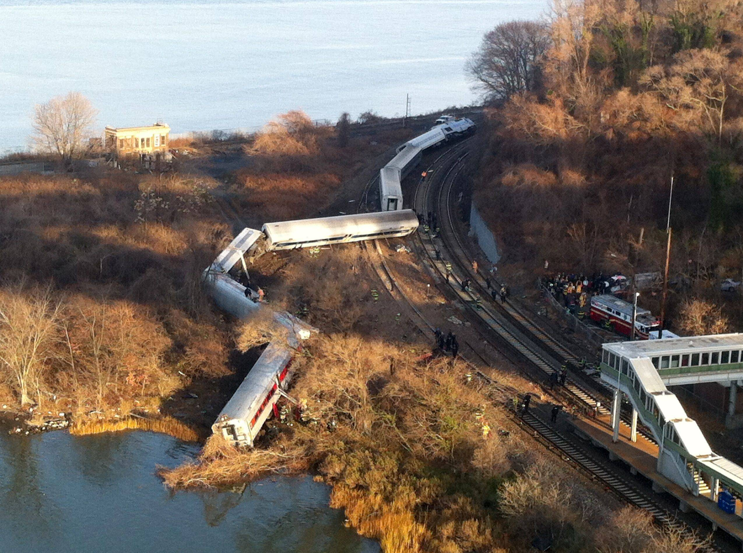 Cars from a Metro-North passenger train are scattered after the train derailed in the Bronx borough of New York Sunday.