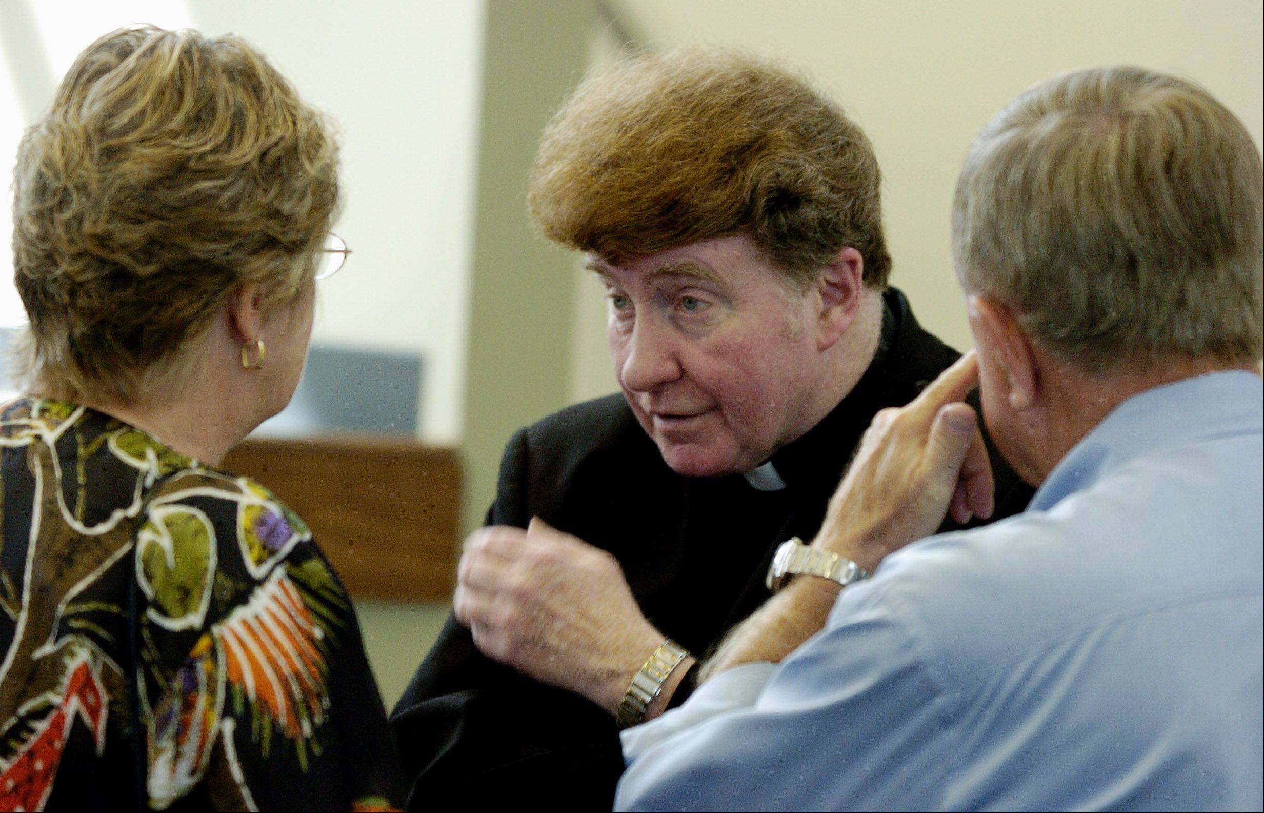 The Rev. Patrick Brennan, shown here speaking with parishioners at Holy Family Parish in Inverness after the dedication of a parish center bearing his name, died Saturday at 66. He�s being remembered as an inspirational leader and speaker who helped grow the church by more than 1,000 families.
