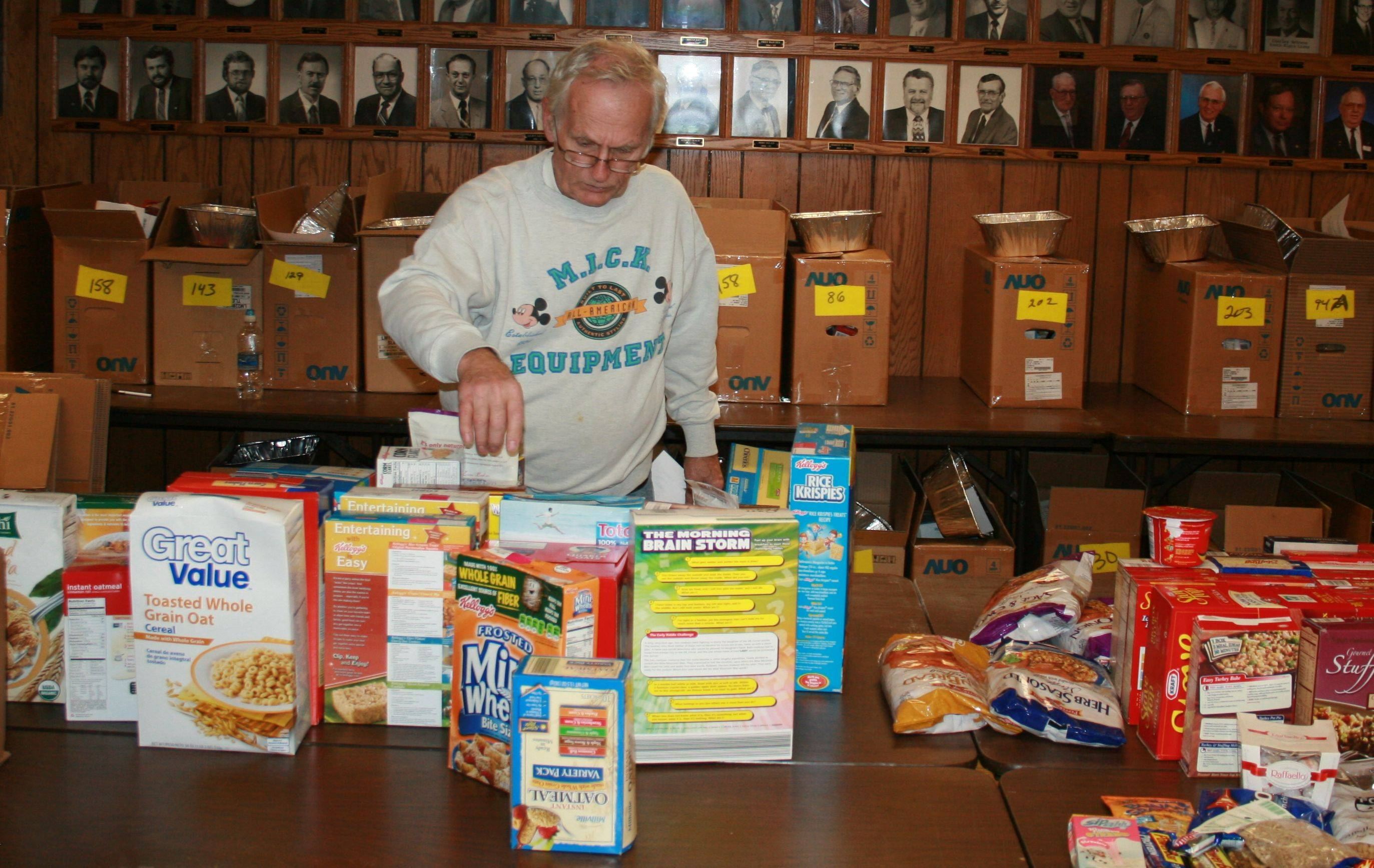 South Elgin Lions Club member Allan Shelton sorts food intended for baskets for area families.