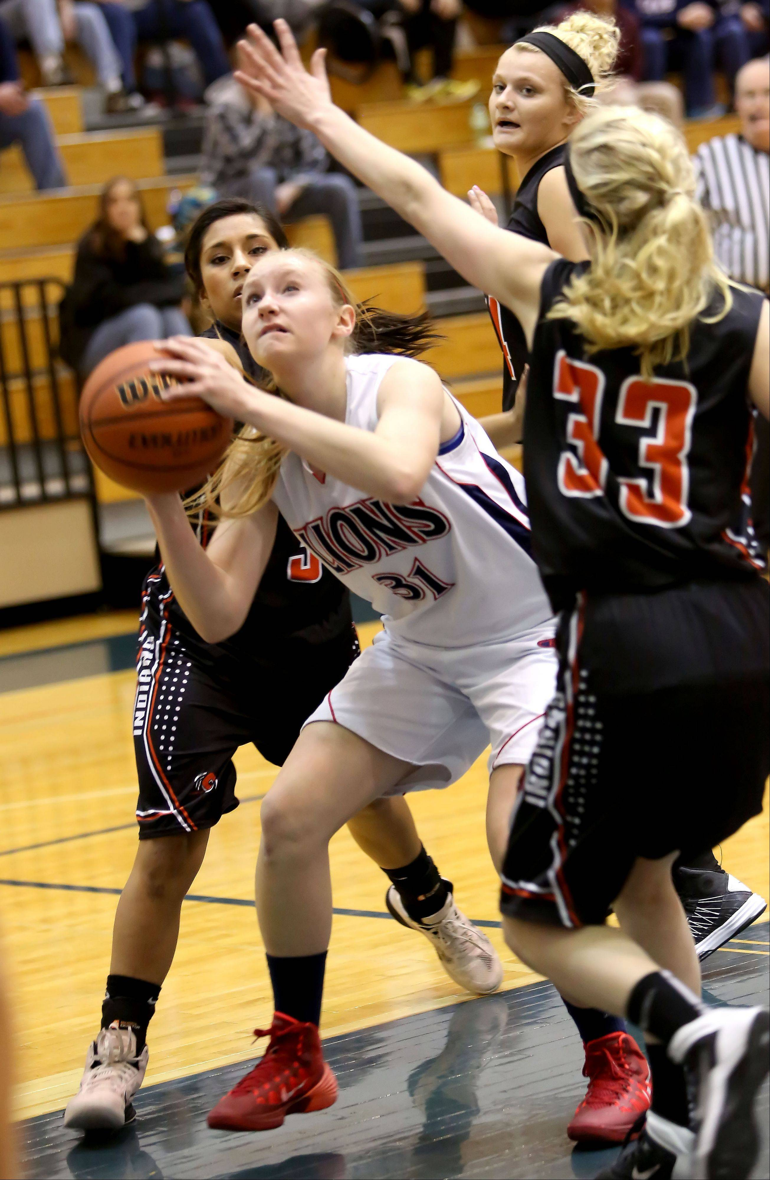 Lisle's Sarah Mogensen looks for room to shoot in action against Sandwich during girls basketball on Monday.