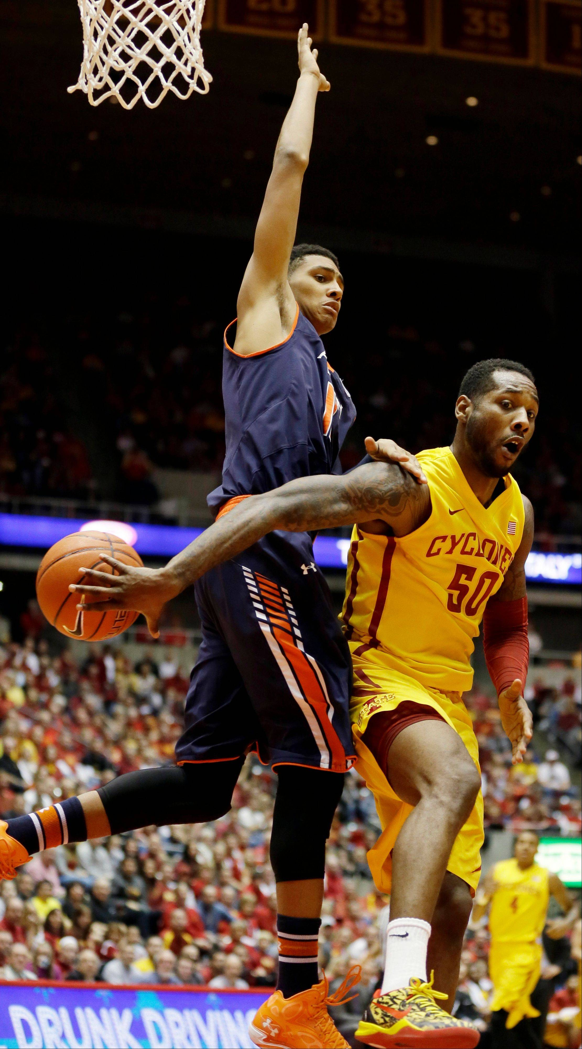 Iowa State guard DeAndre Kane, right, passes around Auburn guard Dion Wade during the first half of an NCAA college basketball game Monday in Ames, Iowa. Iowa State won 99-70.
