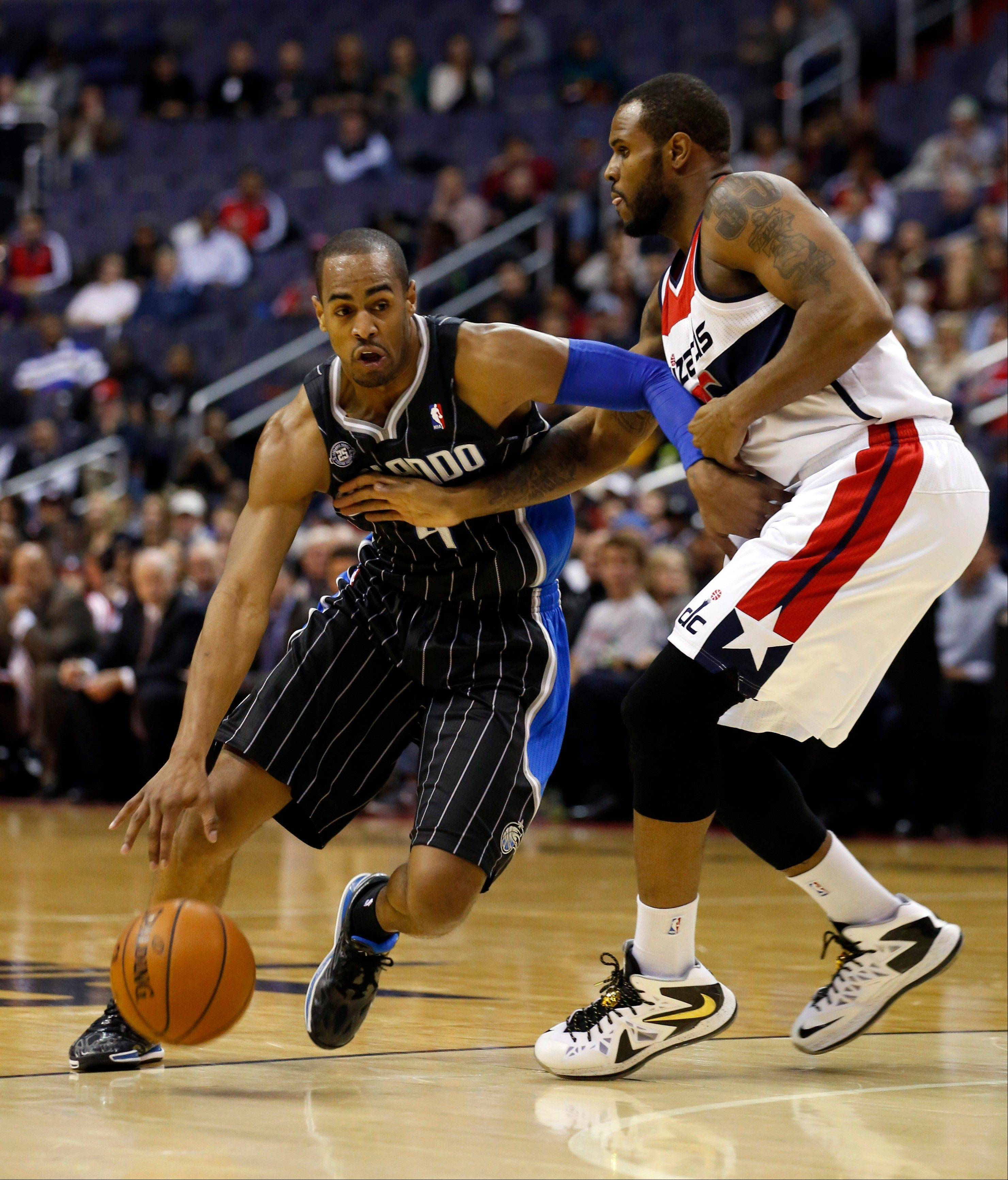 Orlando Magic shooting guard Arron Afflalo (4) drives past Washington Wizards forward Trevor Booker (35) in the first half of an NBA basketball game Monday in Washington.
