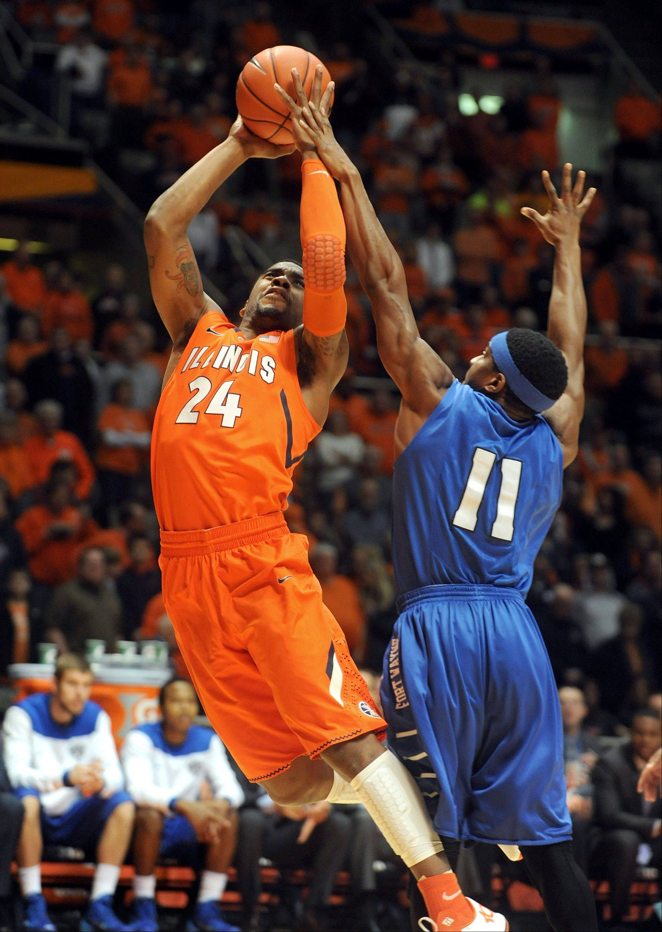 Illinois guard Rayvonte Rice (24) goes up for a basket against IPFW�s Isaiah McCray during the first half at State Farm Center in Champaign.