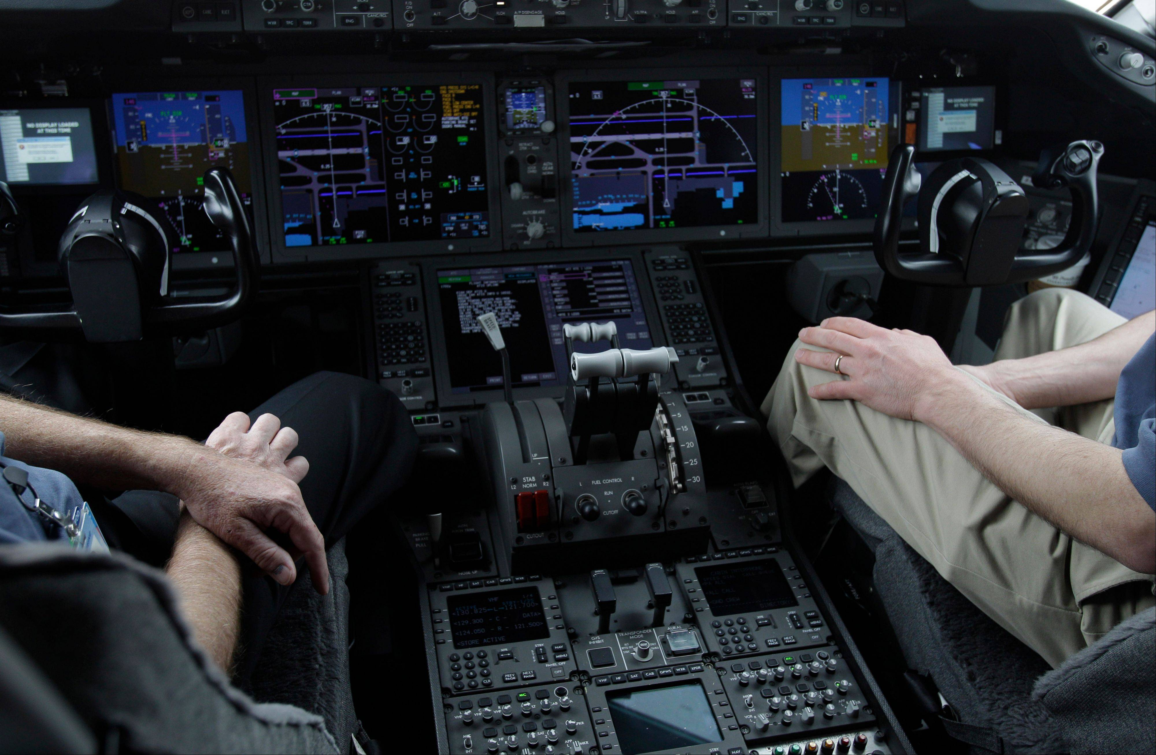 In this Feb. 3, 2011, photo, the cockpit of Boeings' new 787 Dreamliner is photographed in Houston. Pilots are becoming so reliant on the computer systems that do most of the flying in todayís airliners that on the rare occasions when something goes wrong, theyíre sometimes unprepared to take control, according to aviation safety experts and government and industry studies.