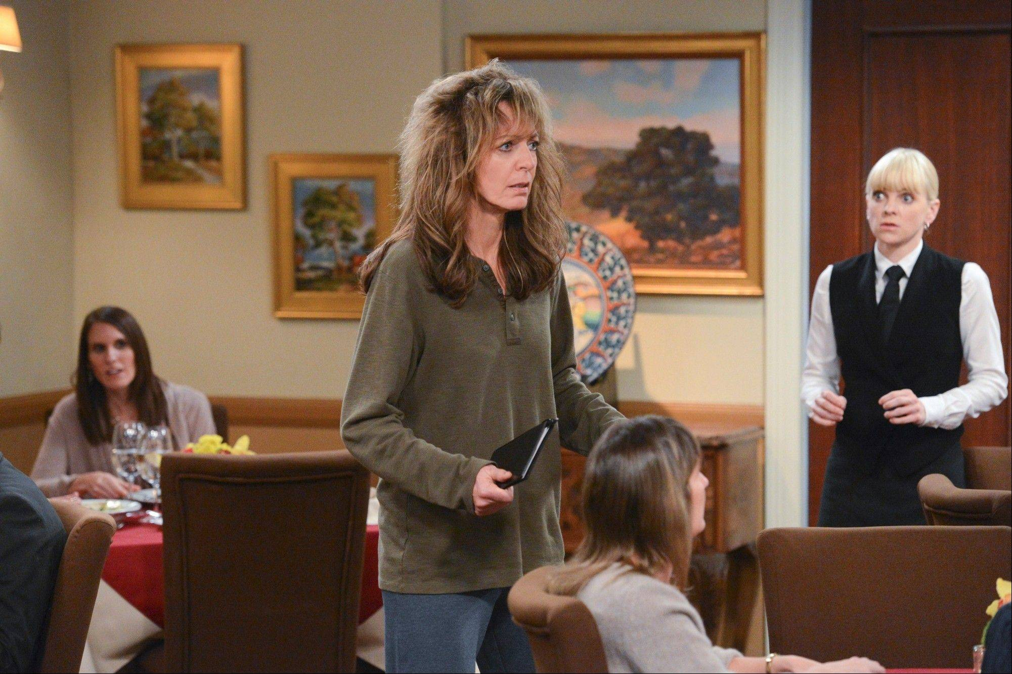 "After a rough night, Bonnie (Allison Janney) shows up at the restaurant where her daughter Christy (Anna Faris, right) works in CBS' ""Mom."""