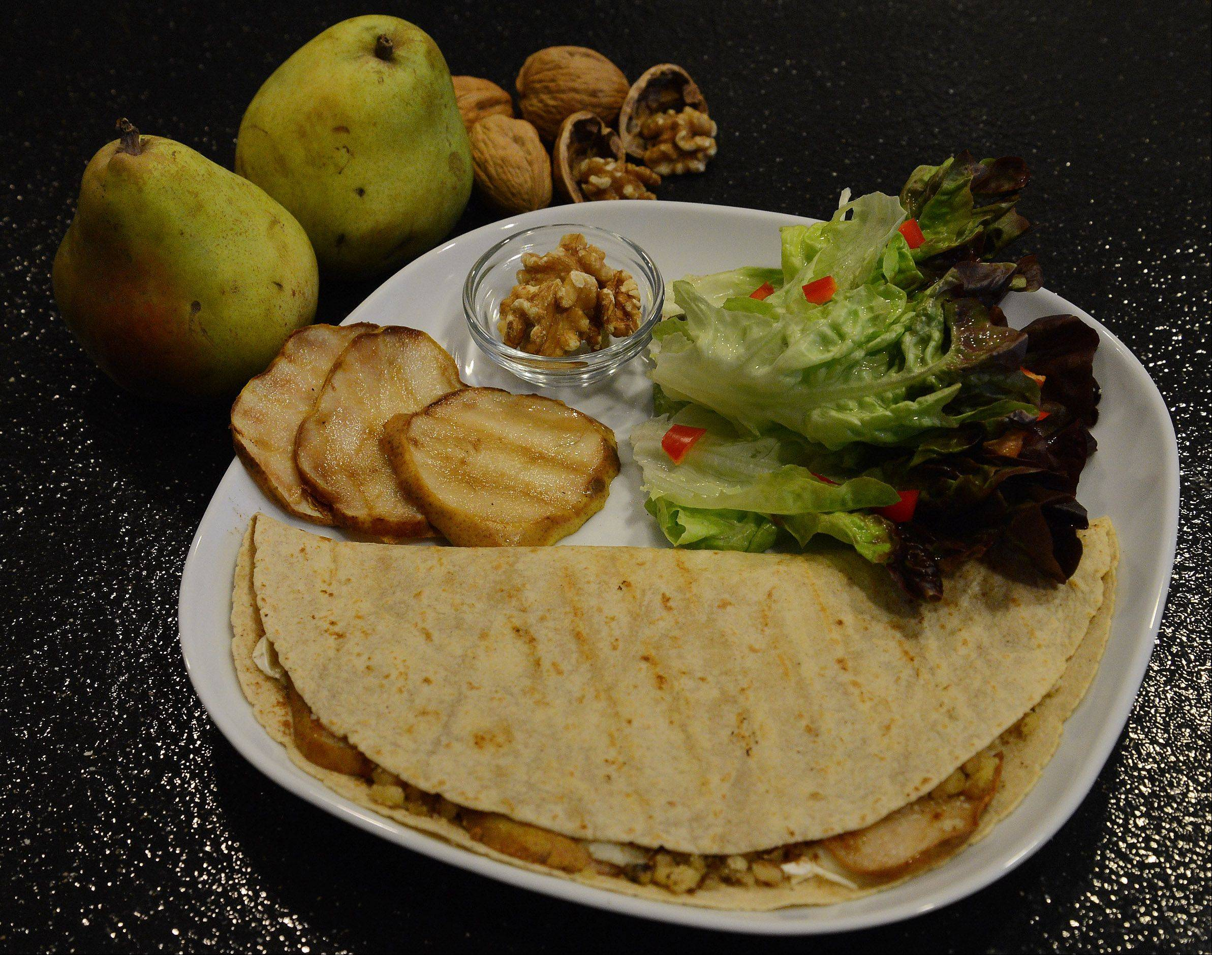 Grilled pears partner with walnuts and brie for a quesadilla that can be an appetizer or entree.