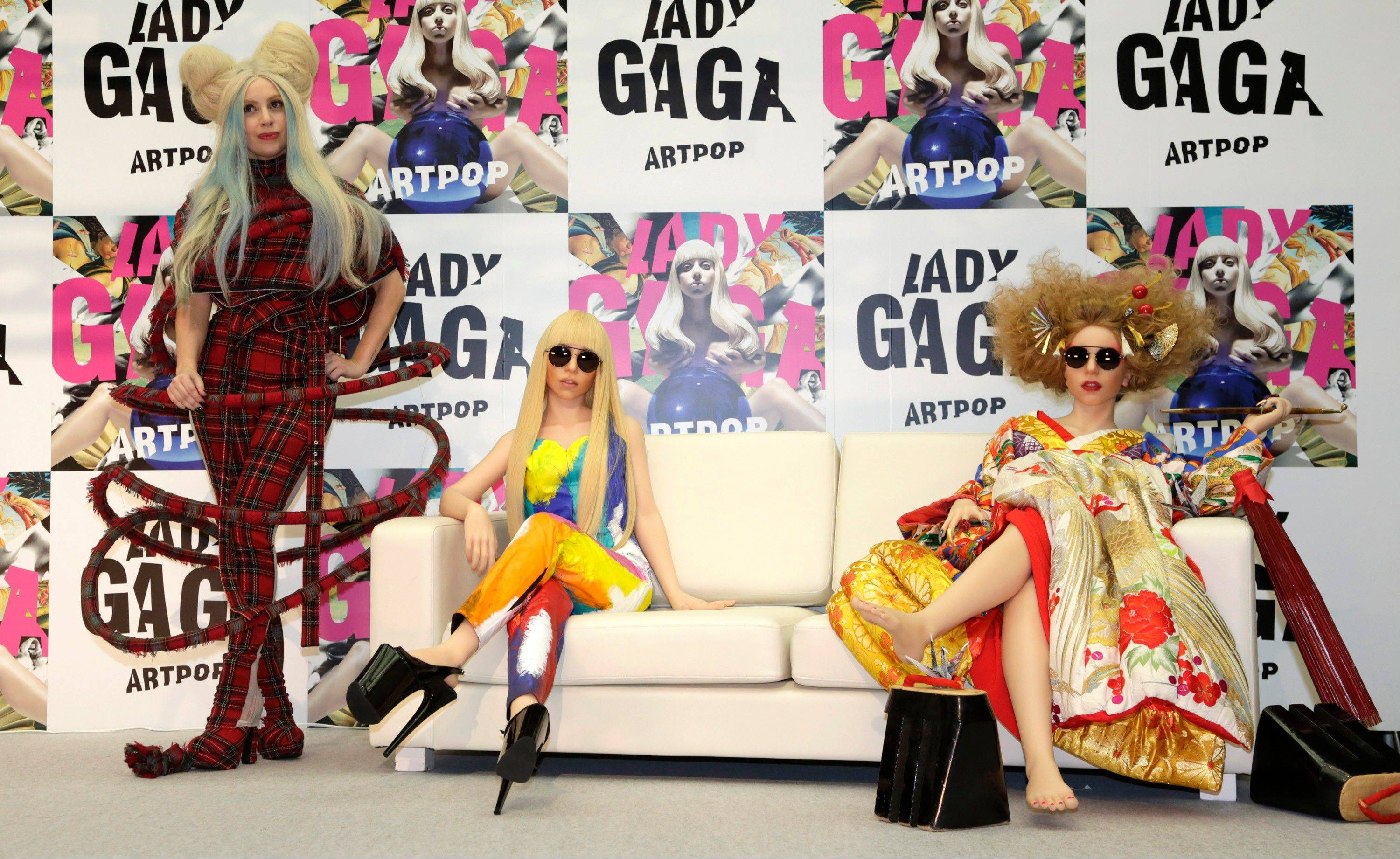 Lady Gaga, left, unveiled life-size dolls in her likeness, dressed in her flamboyant costumes, at a Tokyo event Sunday.