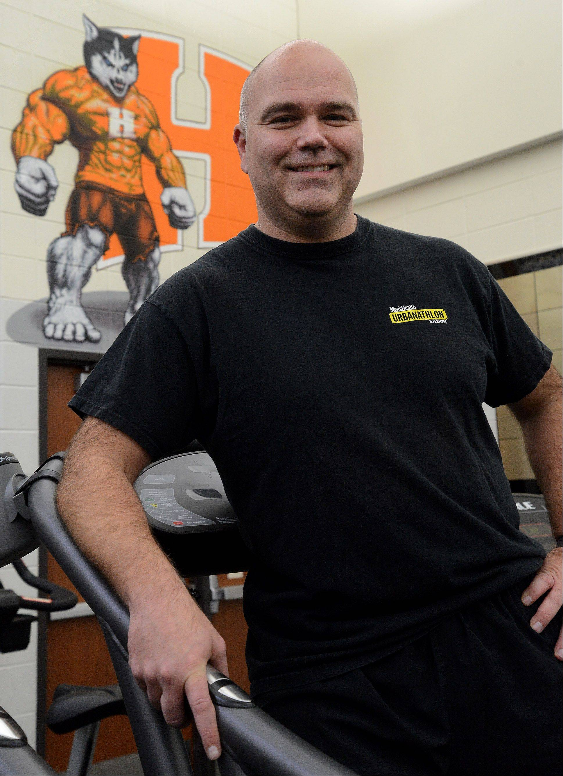 Fittest Loser competitor Greg Moehrlin in the Hersey High School workout room.