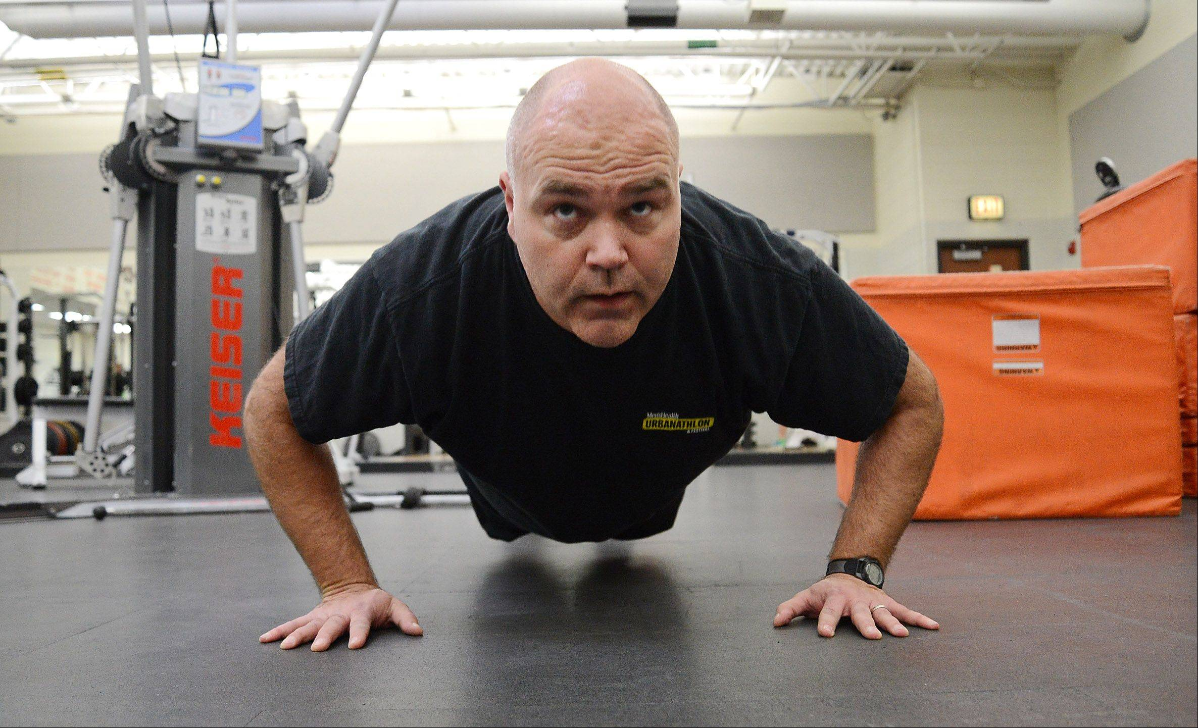 Fittest Loser competitor Greg Moehrlin continues his fitness regimen in the Hersey High School workout room.
