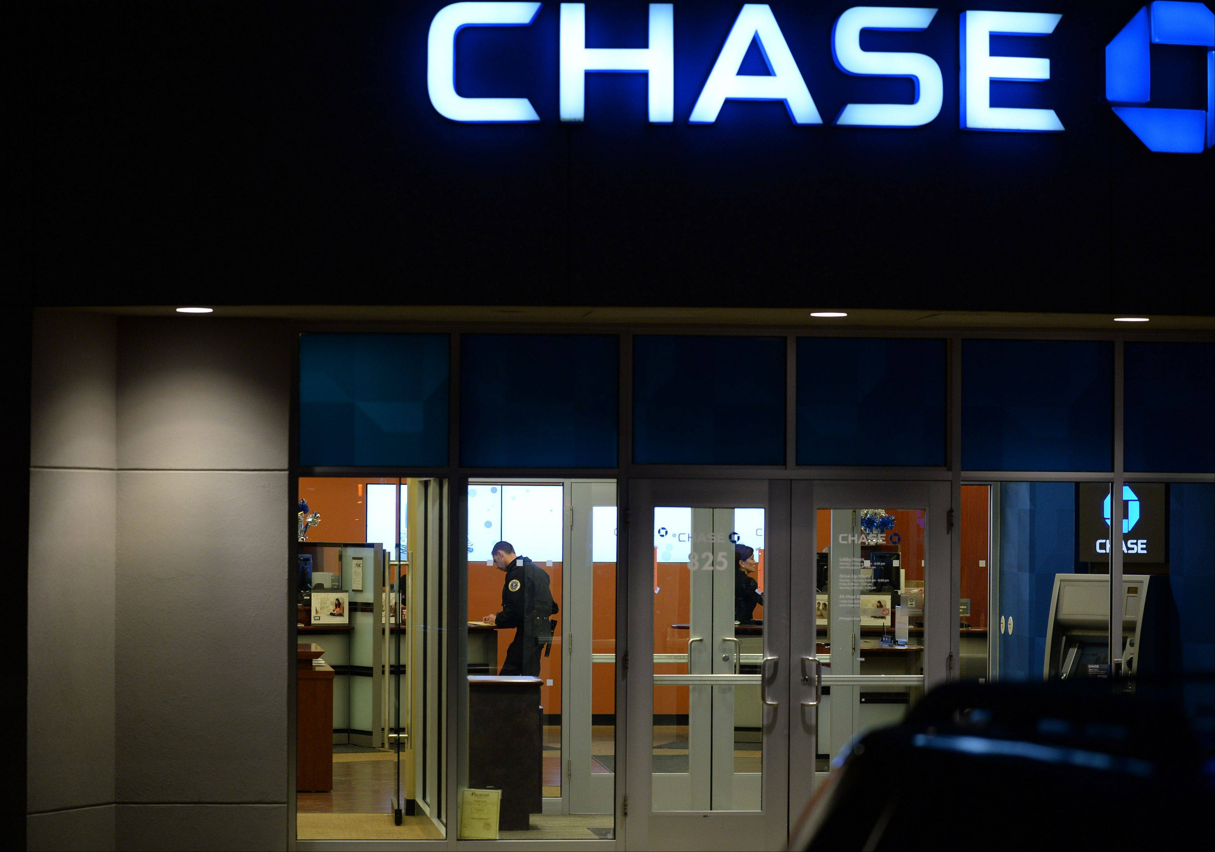 Palatine police take information from inside the Chase bank in Palatine after a bank robbery on Monday.