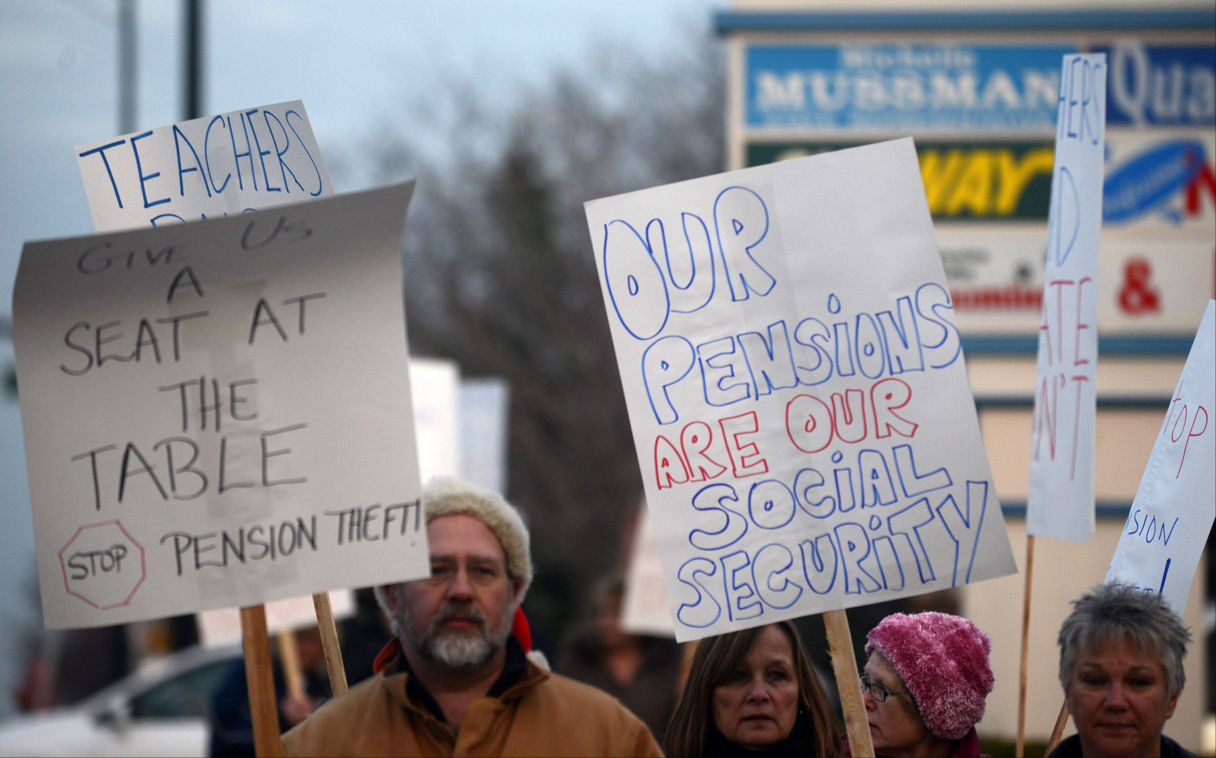 About 50 teachers and other state employees demonstrated and met with state Rep. Michelle Mussmann outside her Schaumburg office Monday to oppose cuts to pension benefits.