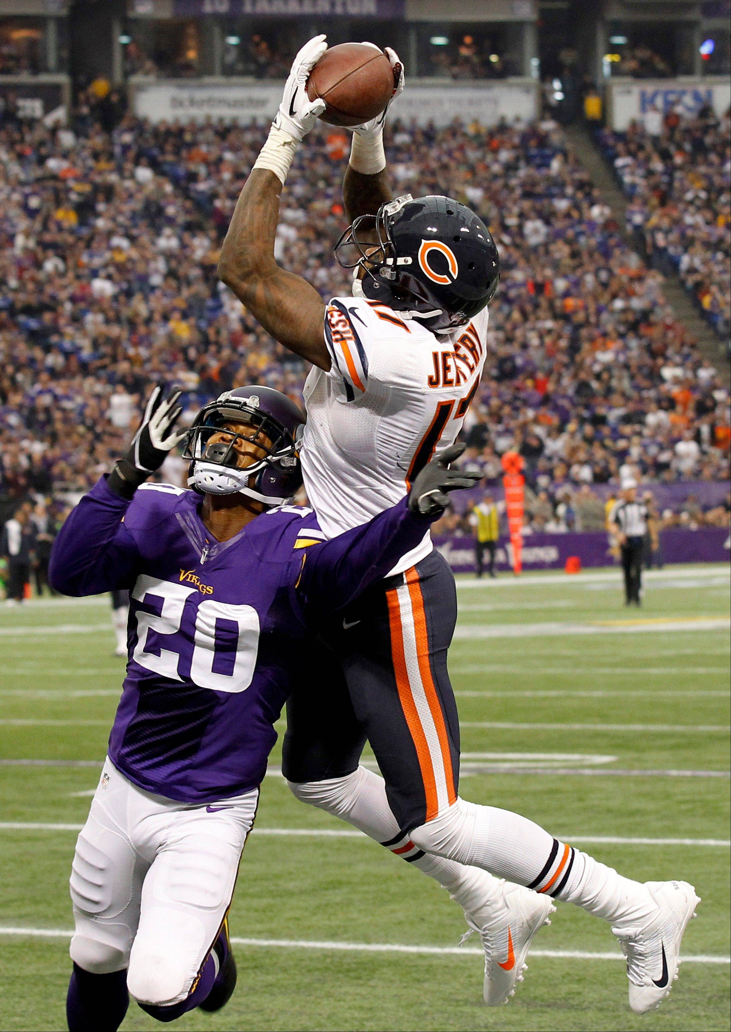 Bears wide receiver Alshon Jeffery catches a 46-yard touchdown pass over Minnesota Vikings cornerback Chris Cook during the second half of yesterday's game in Minneapolis. Jeffery was a highlight of the game; the game's ending was not.