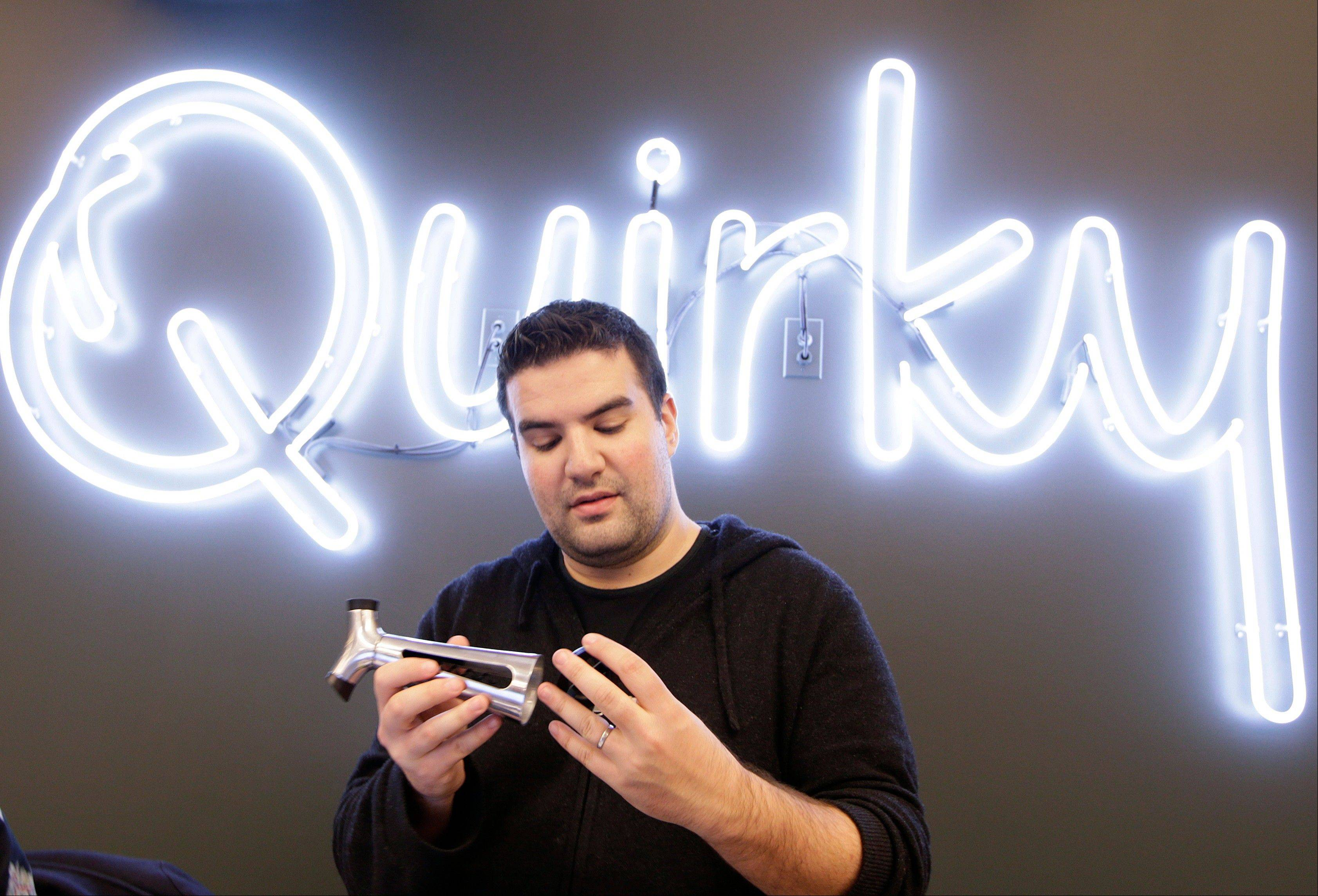 Quirky CEO Ben Kaufman looks at a wine and bottle opener his company markets, in New York. Kaufman created an employee �blackout week� once each quarter in which no one besides the company�s customer service representatives are allowed to work. The startup company shepherds inventions to the marketplace.