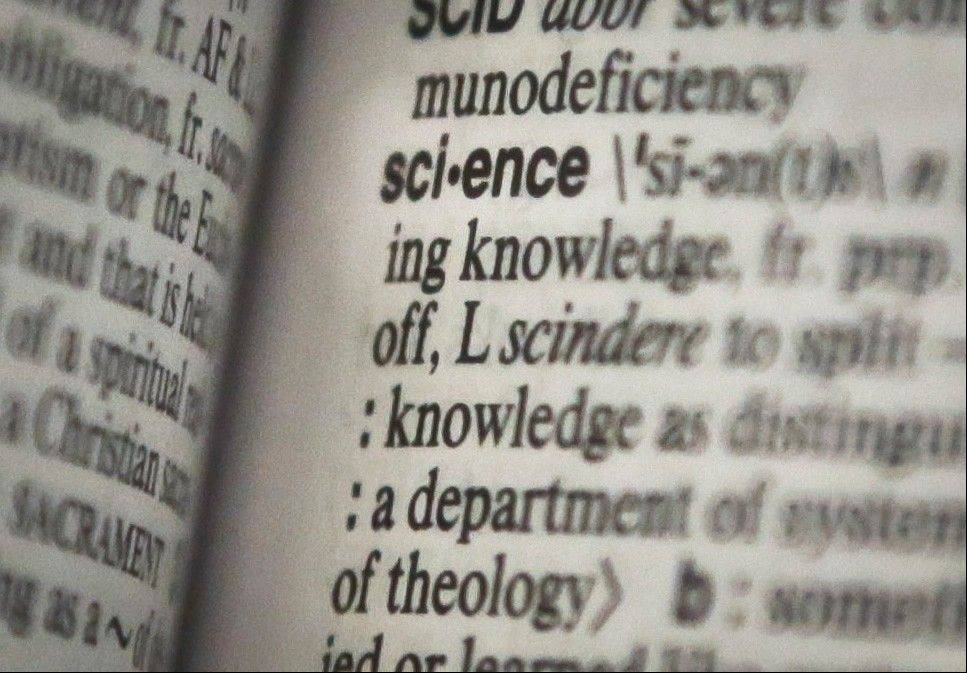The word �science� is een on a page of a Merriam-Webster dictionary. �Science� is the publisher�s word of the year.