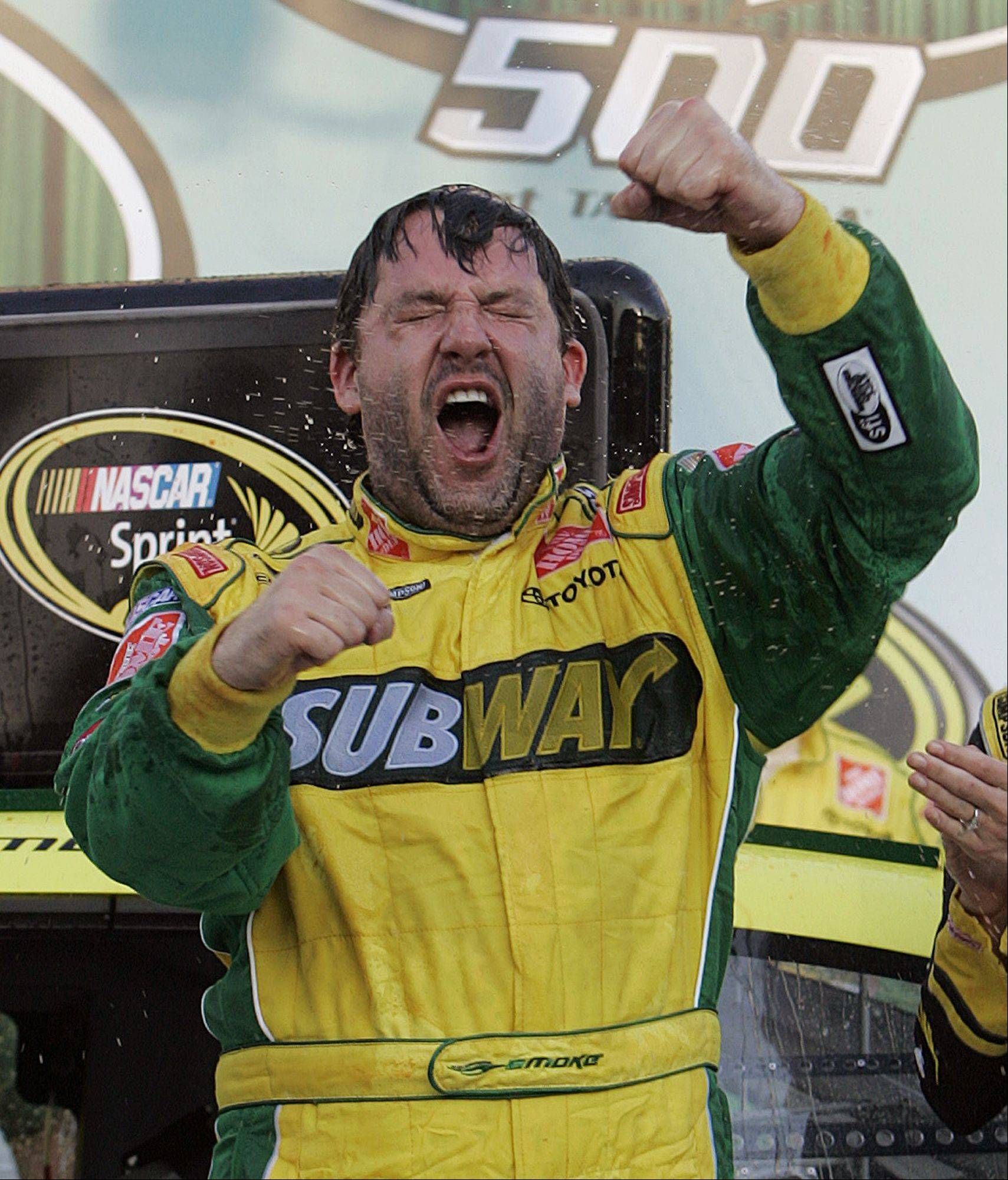 Tony Stewart reacts in victory lane after winning the NASCAR Sprint Cup Series� AMP Energy 500 auto race at Talladega Superspeedway in Talladega, Ala., in 2008.